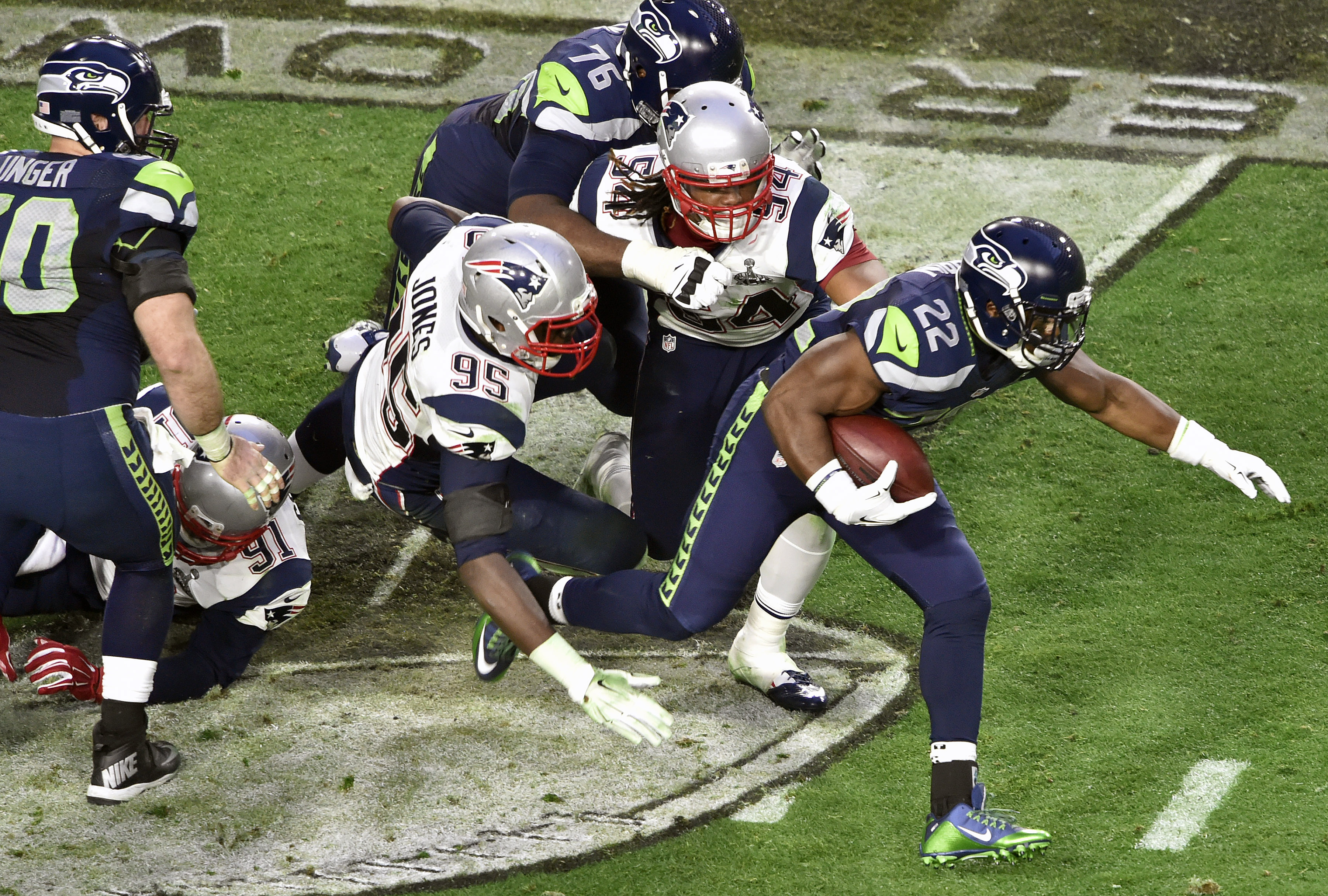 Robert Turbin #22 of the Seattle Seahawks carries the ball against the New England Patriots during Super Bowl XLIX February 1, 2015 at the University of Phoenix Stadium in Glendale, Arizona.
