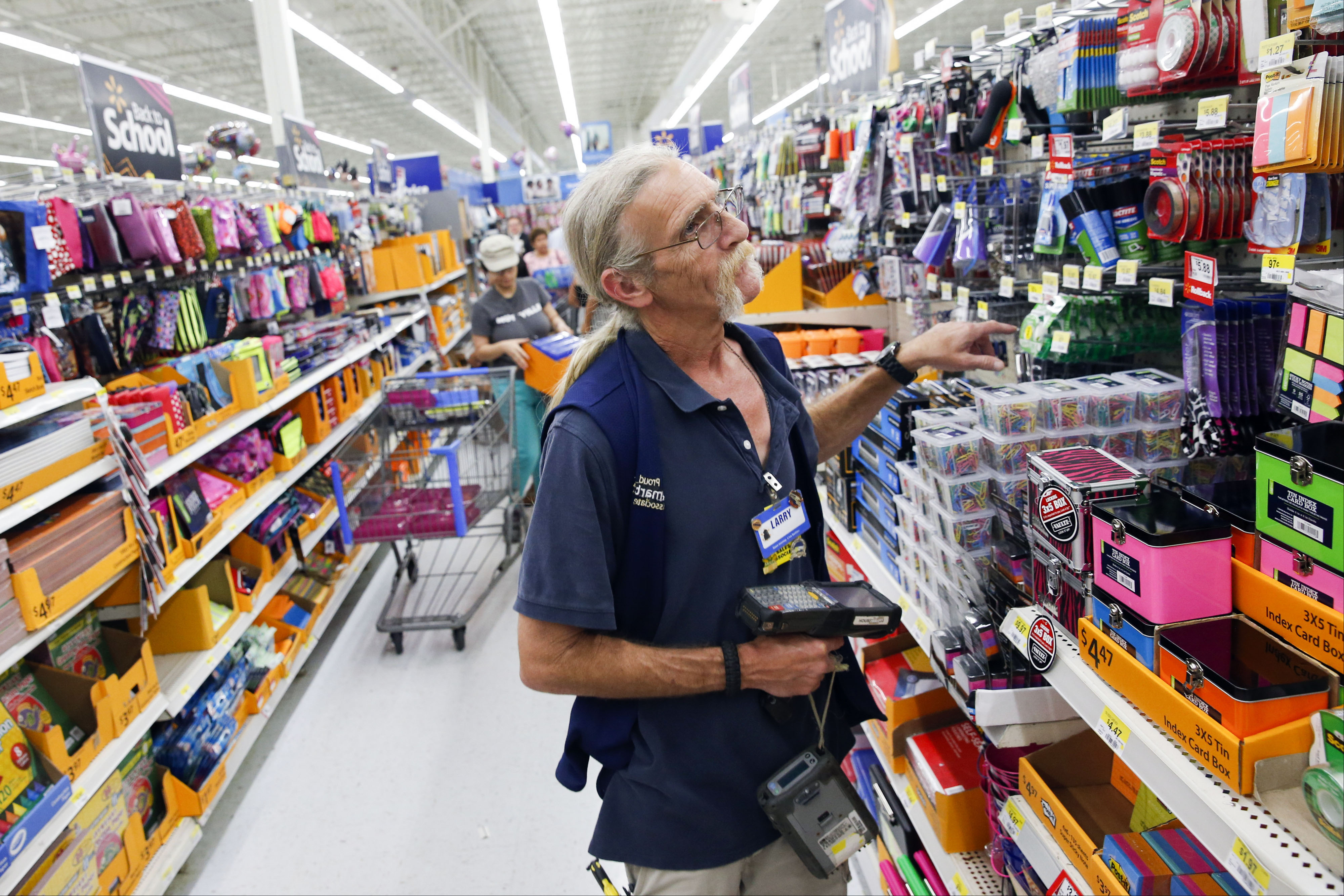 A Wal-Mart Stores Inc. associate checks inventory of school supplies at a Wal-Mart Stores Inc. location in the Porter Ranch neighborhood of Los Angeles, California, U.S., on Thursday, August 6, 2015.