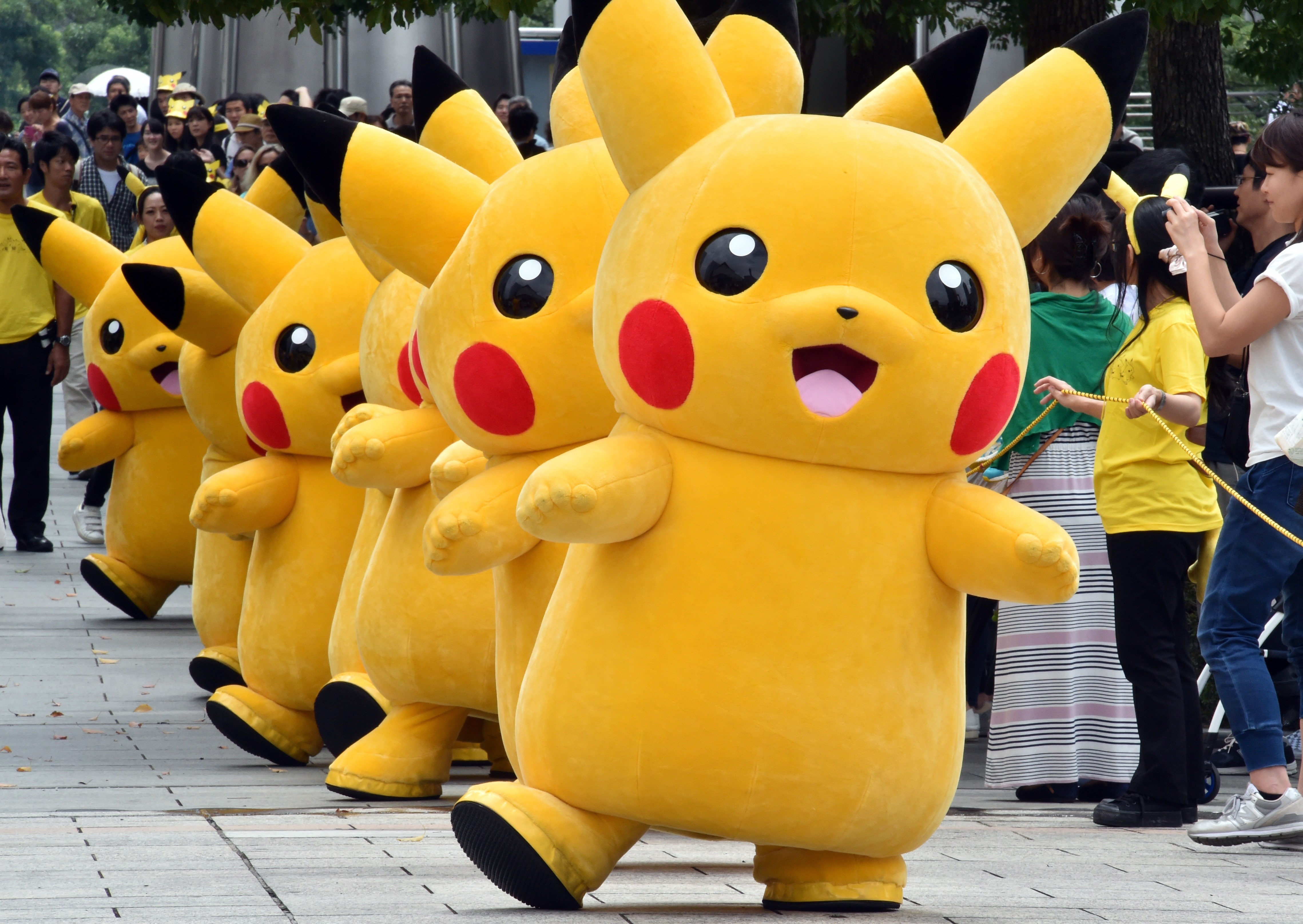 Dozens of Pikachu characters, the famous character of Nintendo's videogame software Pokemon, march at the Landmark Plaza shopping mall in Yokohama, suburban Tokyo on August 13, 2015.