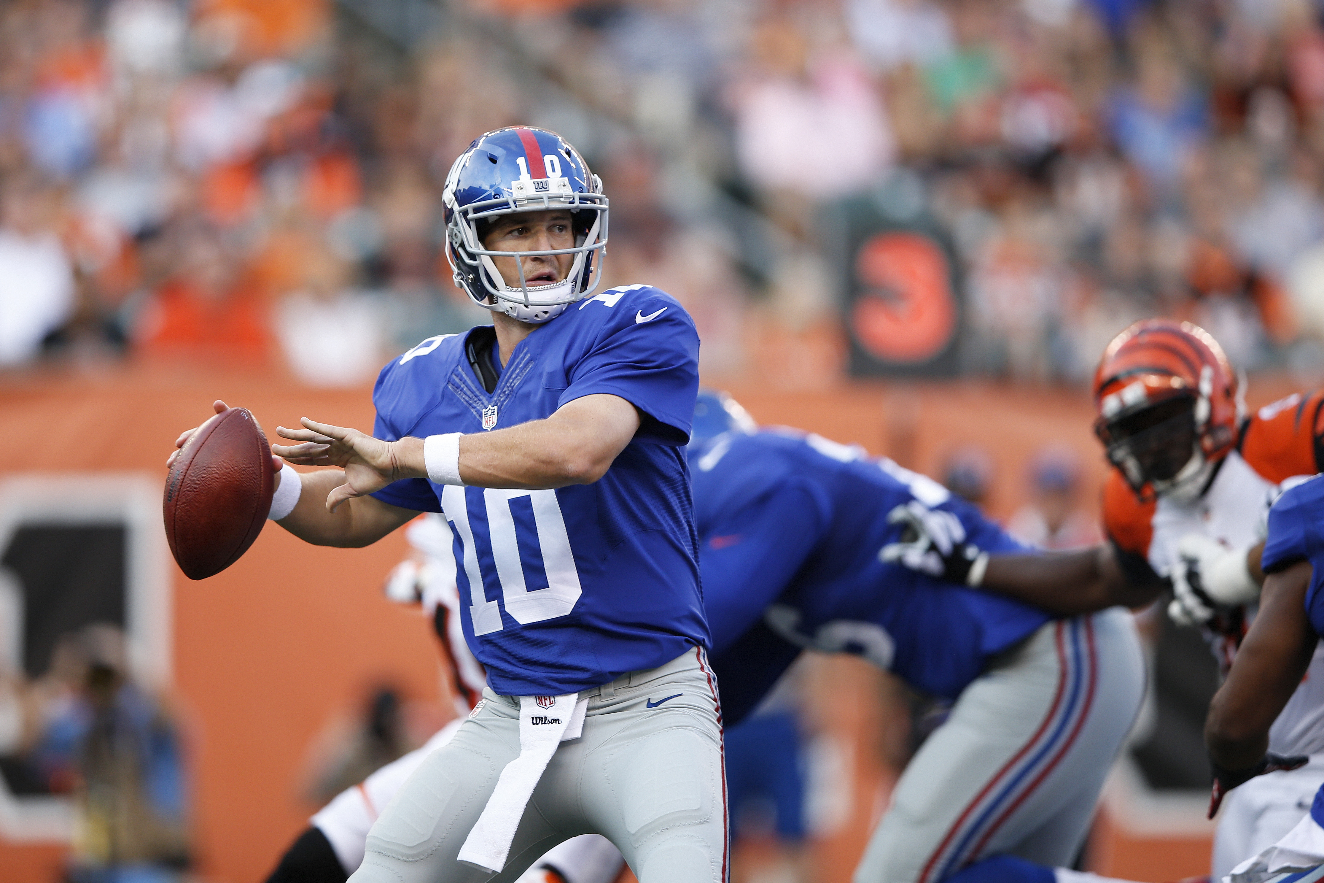 Eli Manning #10 of the New York Giants looks to pass against the Cincinnati Bengals during a preseason game at Paul Brown Stadium on August 14, 2015 in Cincinnati, Ohio.