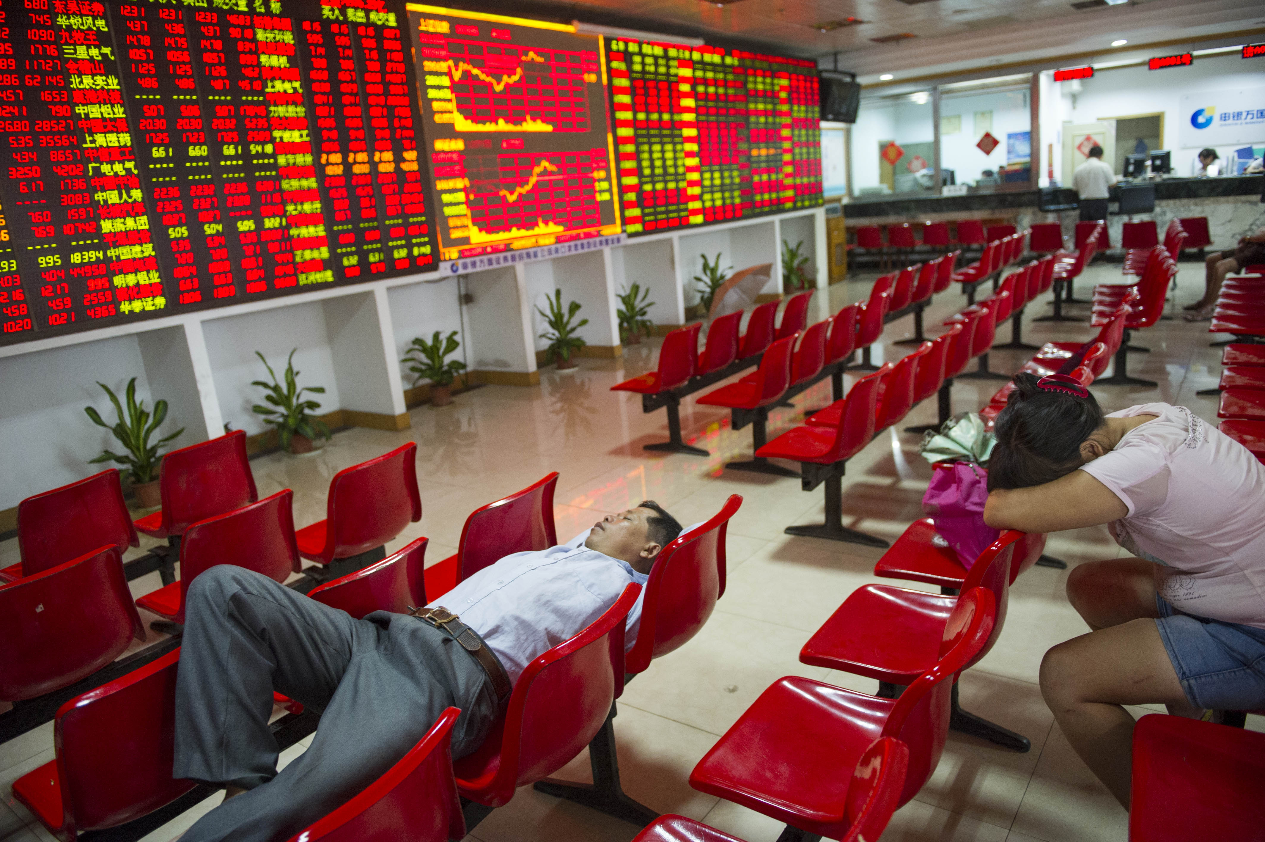 Investors have a rest at a stock exchange hall on August 26, 2015 in Haikou, China.