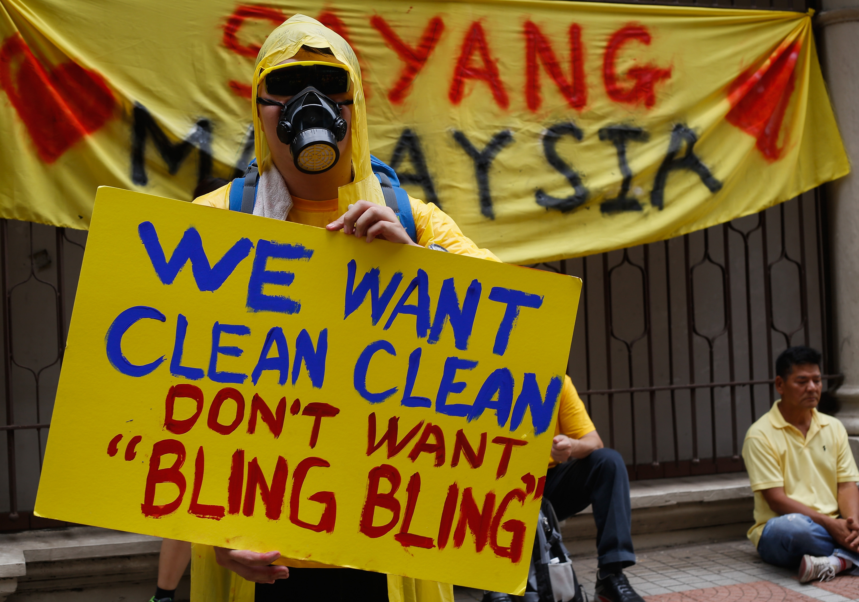 Protesters show a placard during a Bersih (Clean) rally calling for the resignation of Prime Minister Najib Razak on Aug. 30, 2015, in Kuala Lumpur. Najib has become embroiled in a scandal involving state-fund debts and allegations of deposits totaling $700 million paid to his bank account
