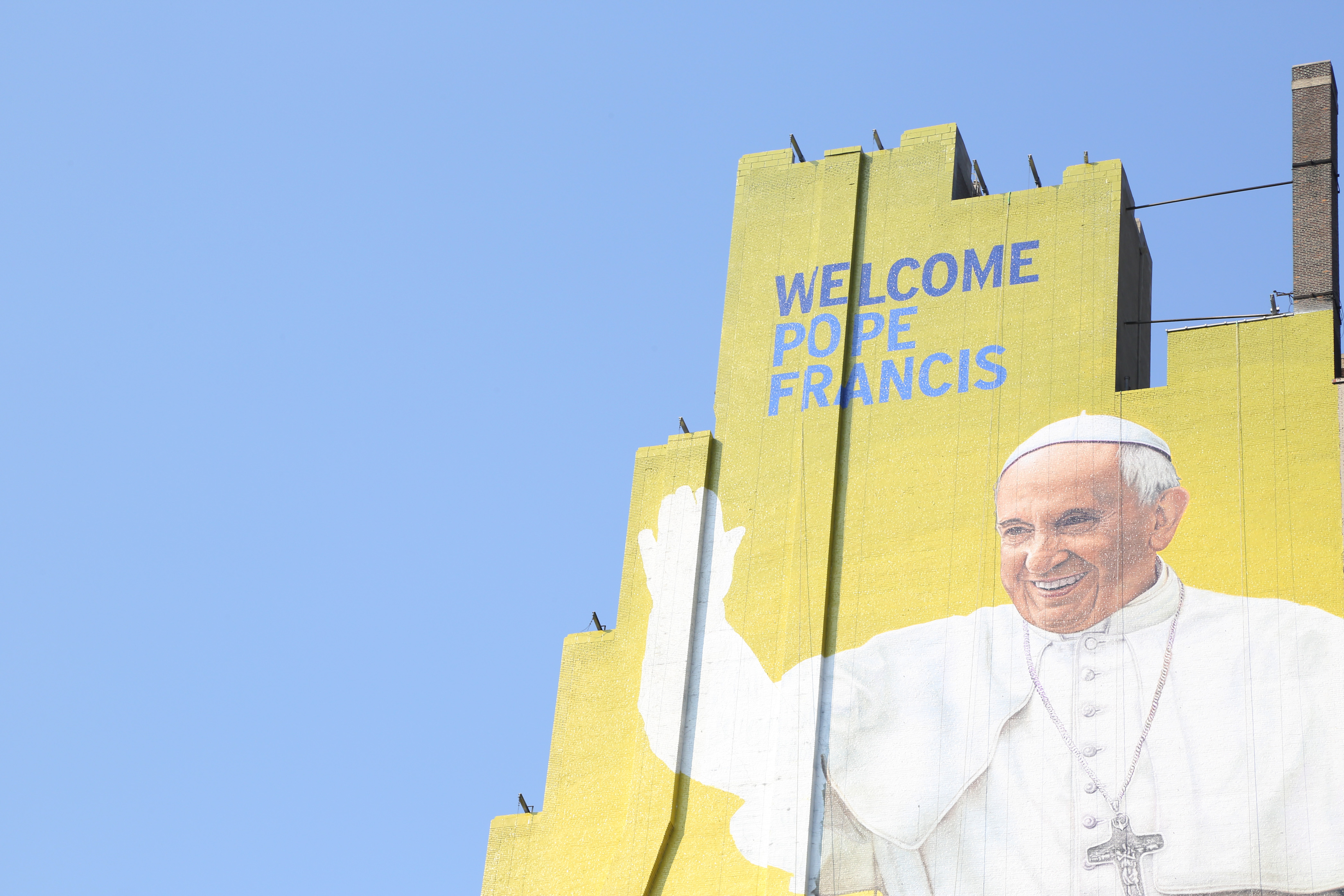 A westside building mural of Pope Francis is almost complete in midtown Manhattan on Sept. 2, 2015 in New York City.