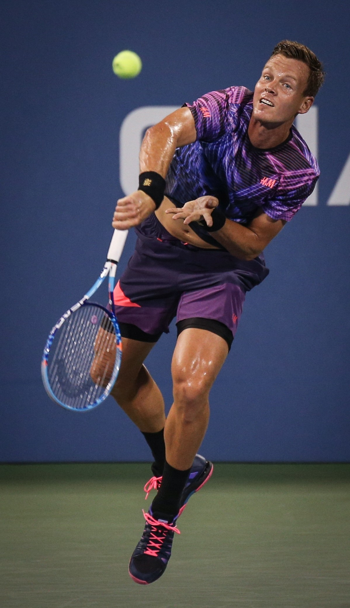 Tomas Berdych of the Czech Republic returns a shot against Richard Gasquet of France during their Men's Singles Fourth Round match on Day Eight of the 2015 US Open on Sept. 7, 2015.