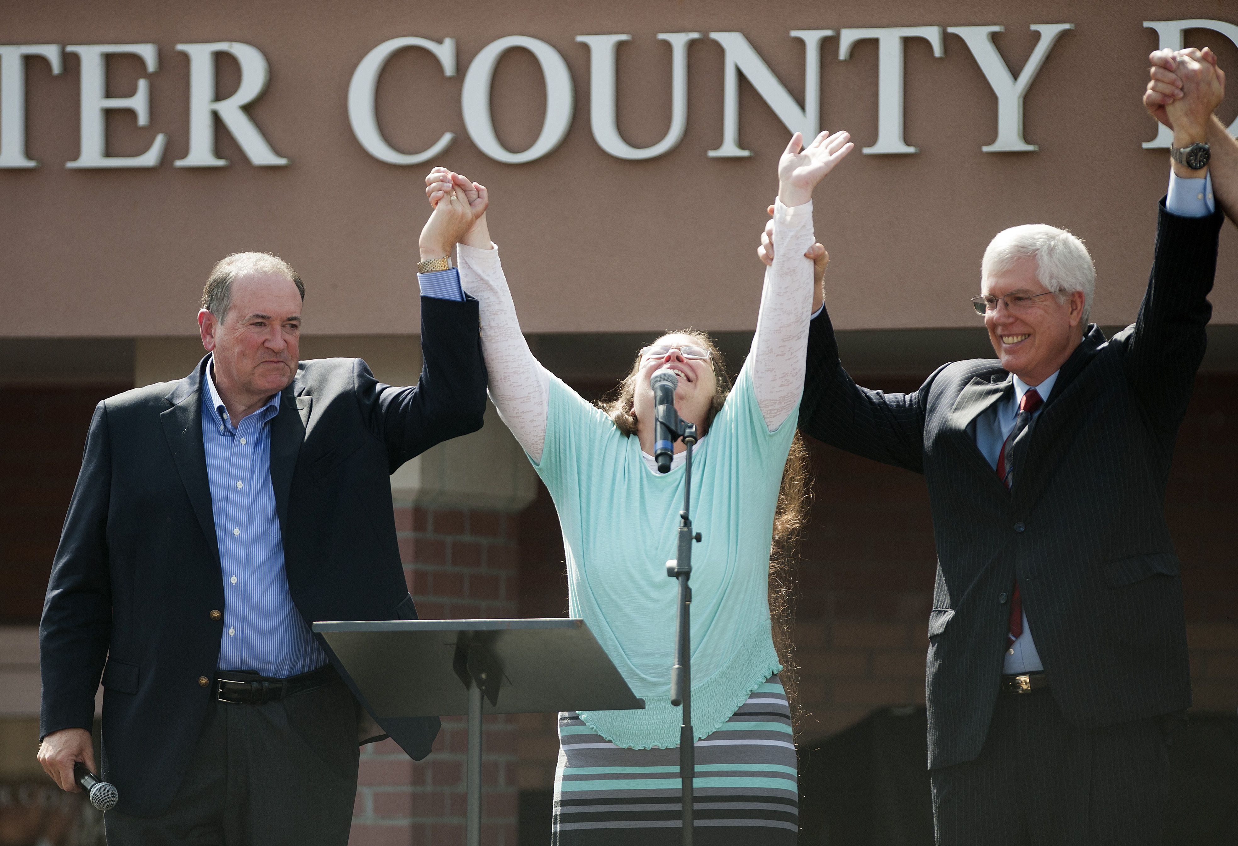 Kim Davis stands with Mike Huckabee after she was released from jail. She was held in contempt of court for refusing to issue gay marriage licenses.