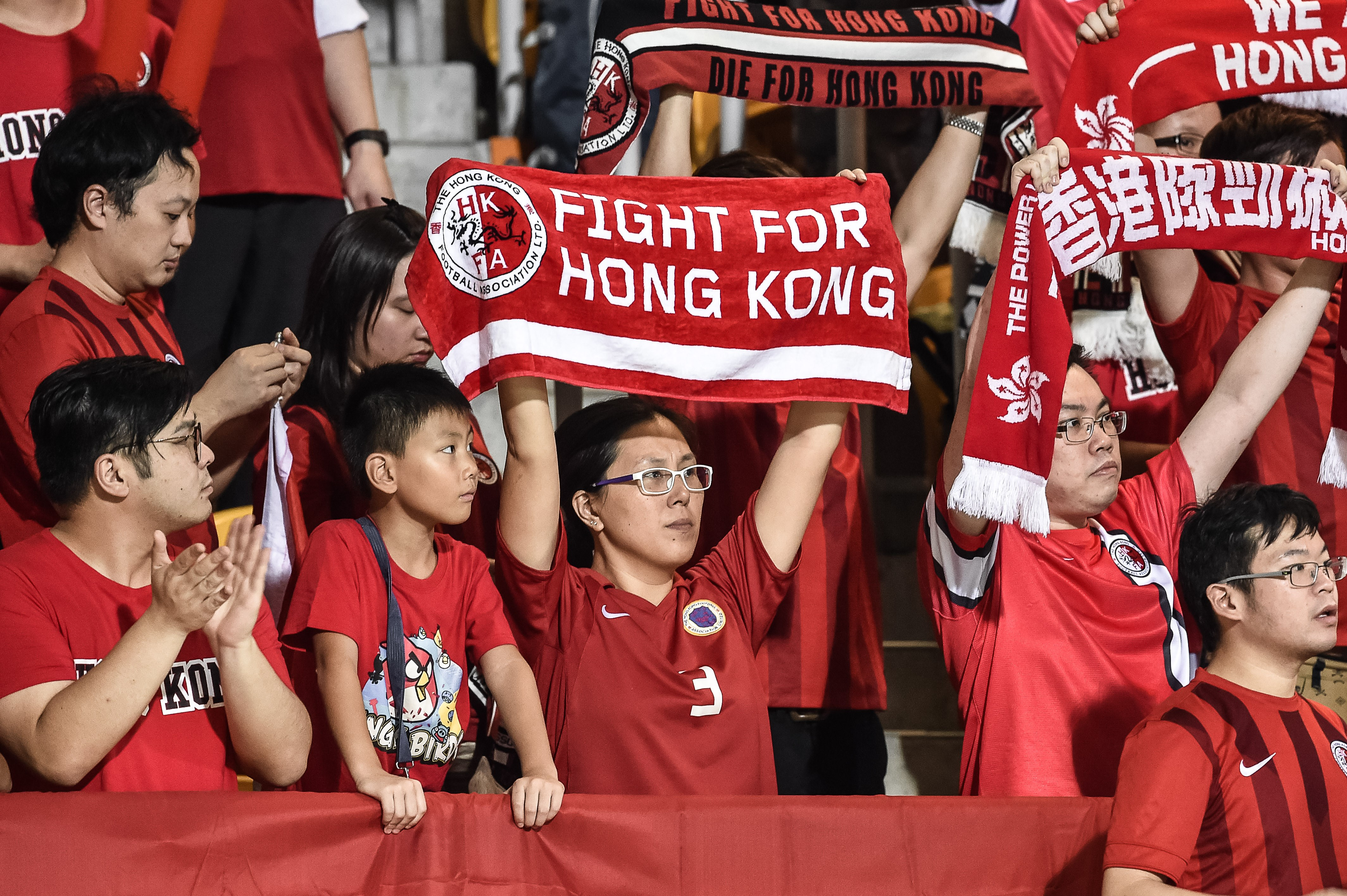 Hong Kong football fans during the 2018 World Cup football qualifying match between Hong Kong and Qatar in Hong Kong on Sept. 8, 2015. The Hong Kong Football Association said they would be  disappointed  if FIFA punished them after fans jeered the Chinese national anthem before they game