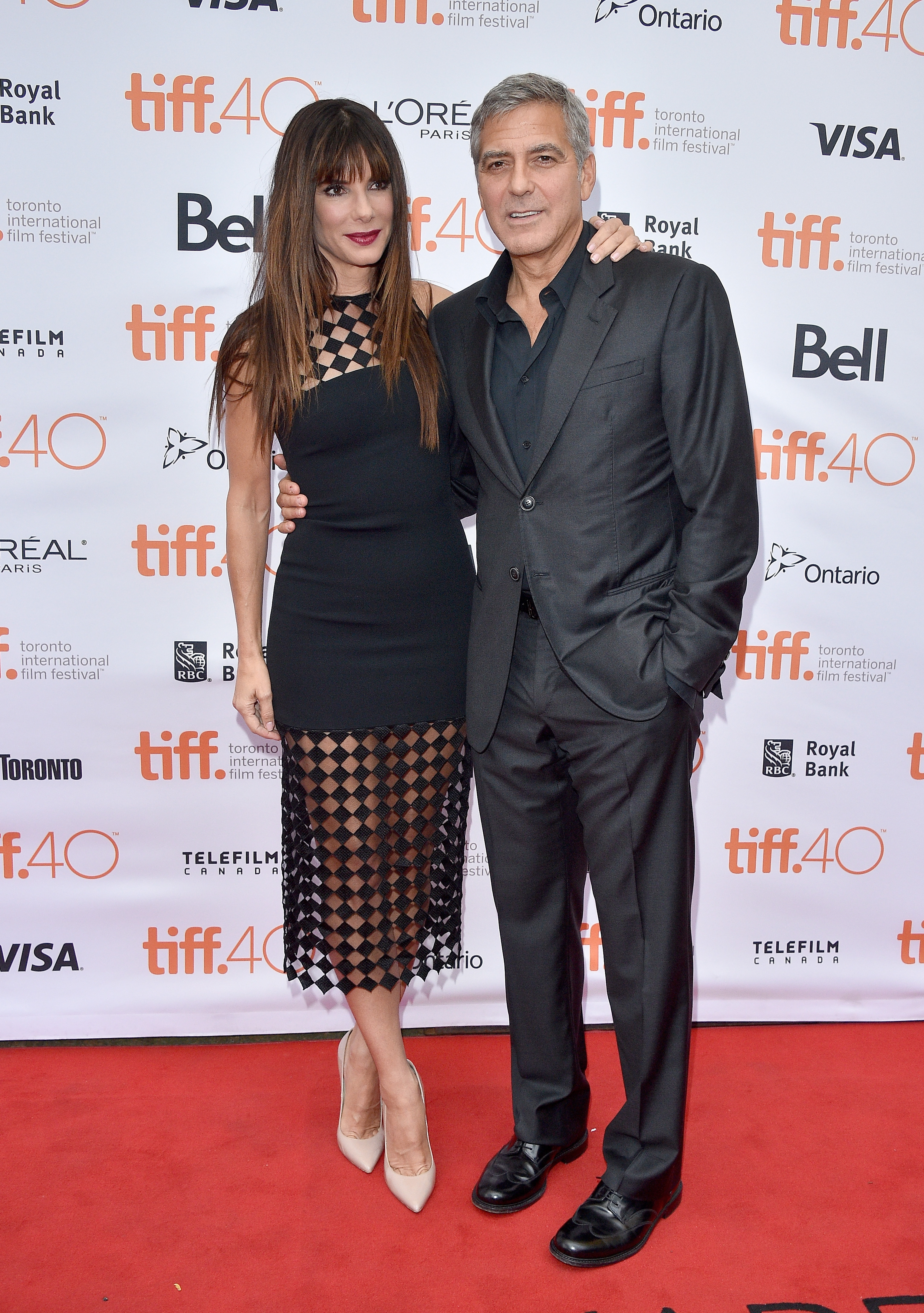 Sandra Bullock and George Clooney attend a premiere during the 2015 Toronto International Film Festival on Sept. 11, 2015.