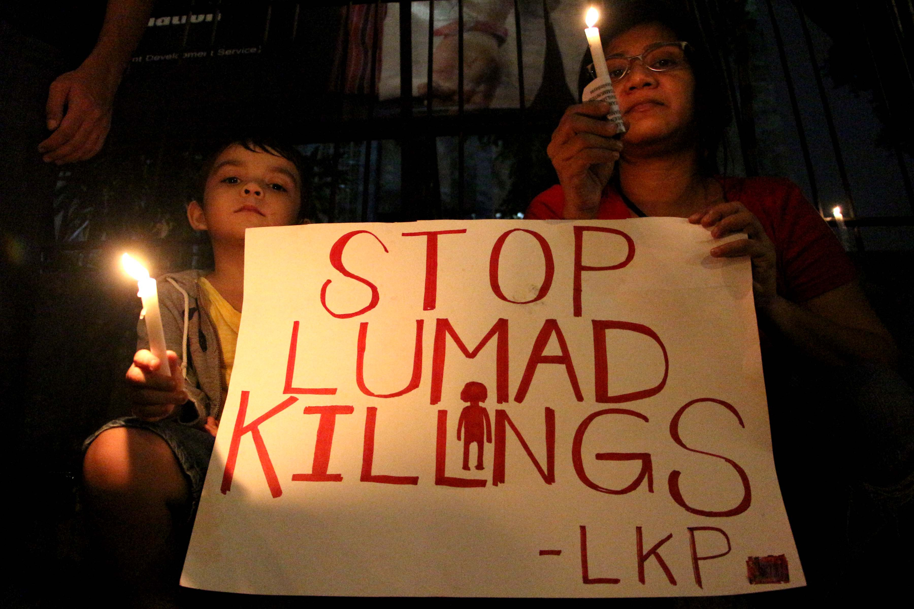 Mourners in Manila join a protest over Lumad killings on Sept. 11, 2015. Many indigenous peoples have been forced to flee their communities