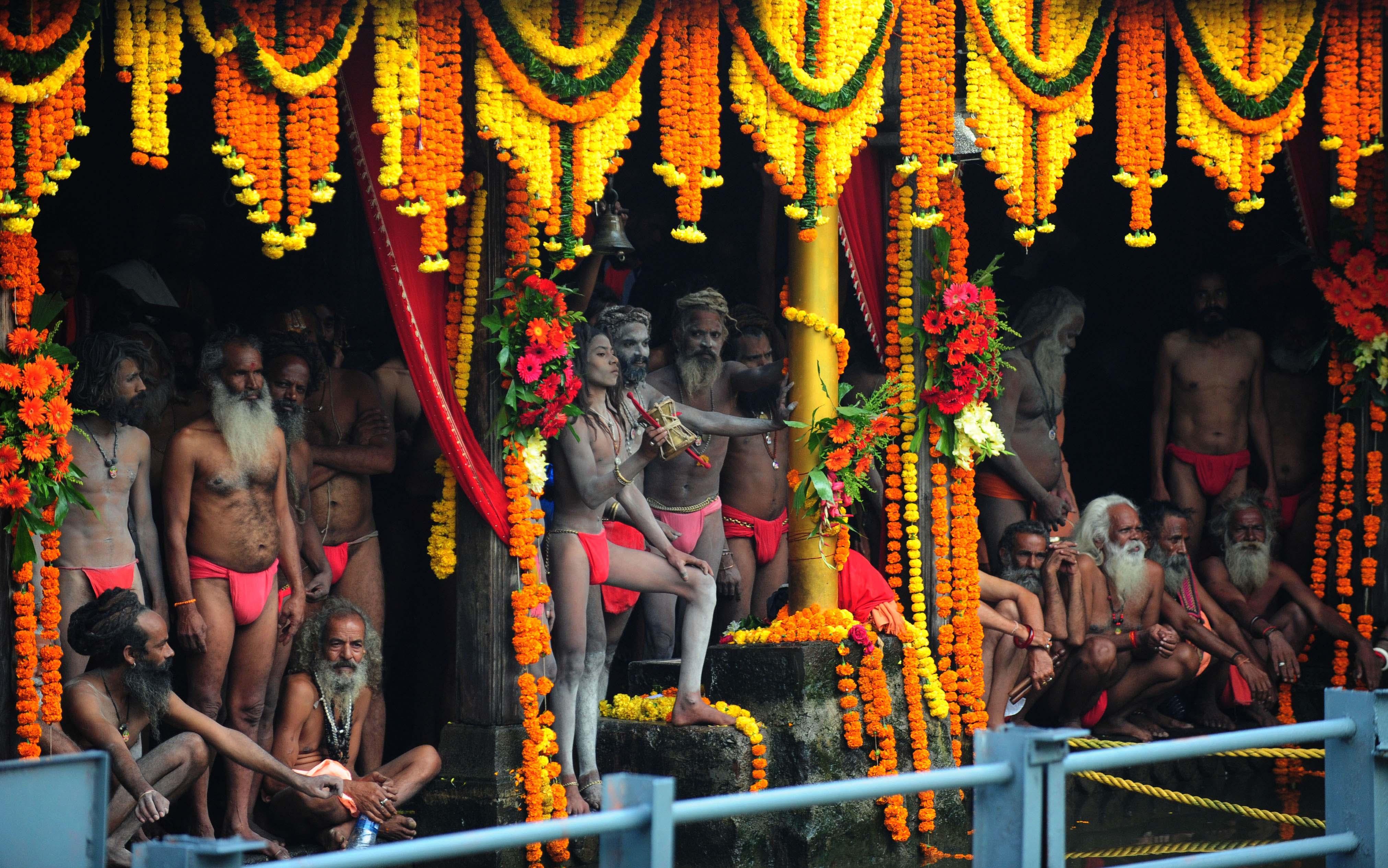 Sadhu's of 10 akharas take bath on auspicious day of Mauni Amavasya during the Maha Kumbh Mela in Nashik, India, on Sept. 13, 2015.