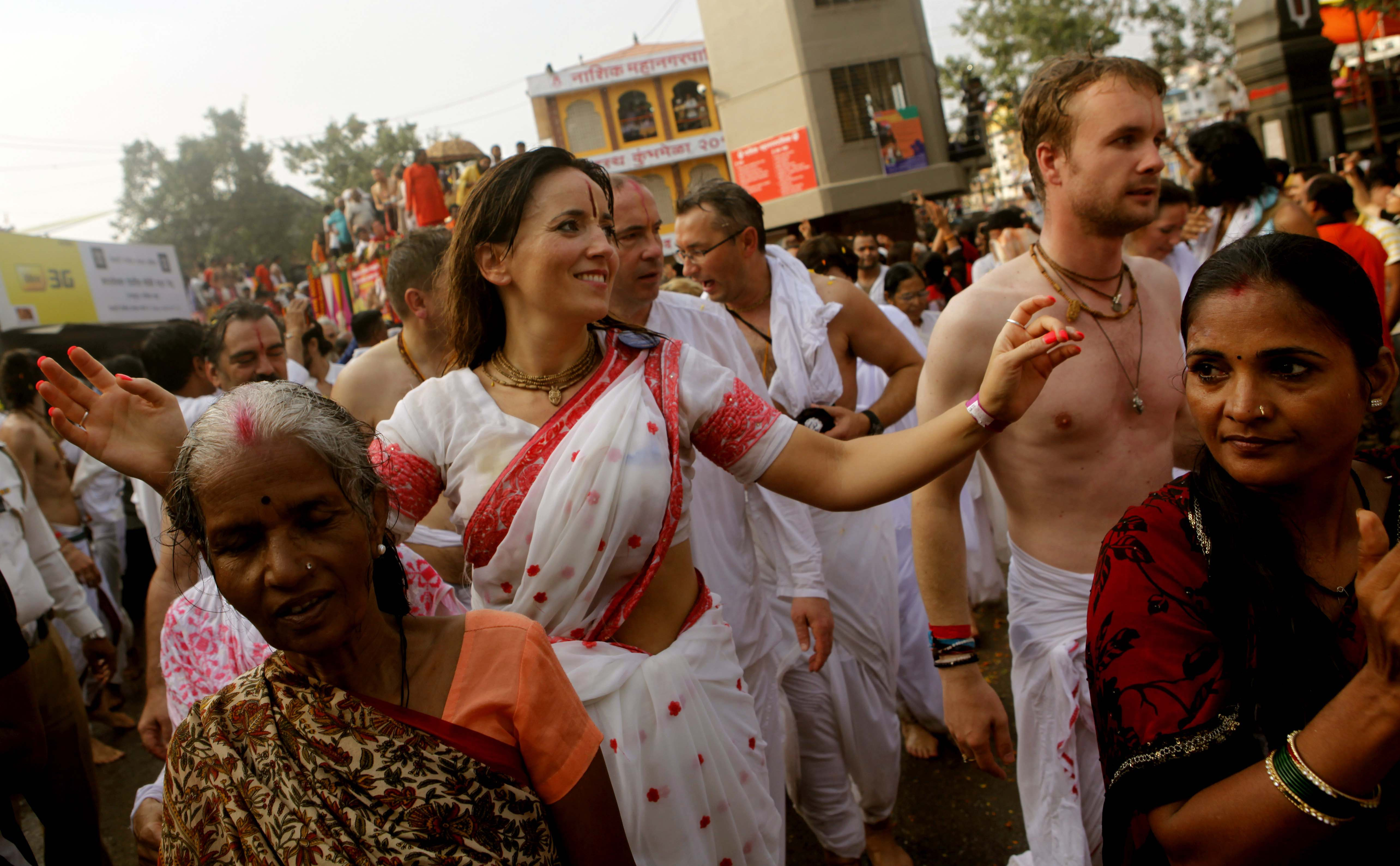 Foreigners join akhadas sadhus during the second Shahi Snan of Simhastha Kumbh Mela in Nashik, India, on Sept. 13, 2015.