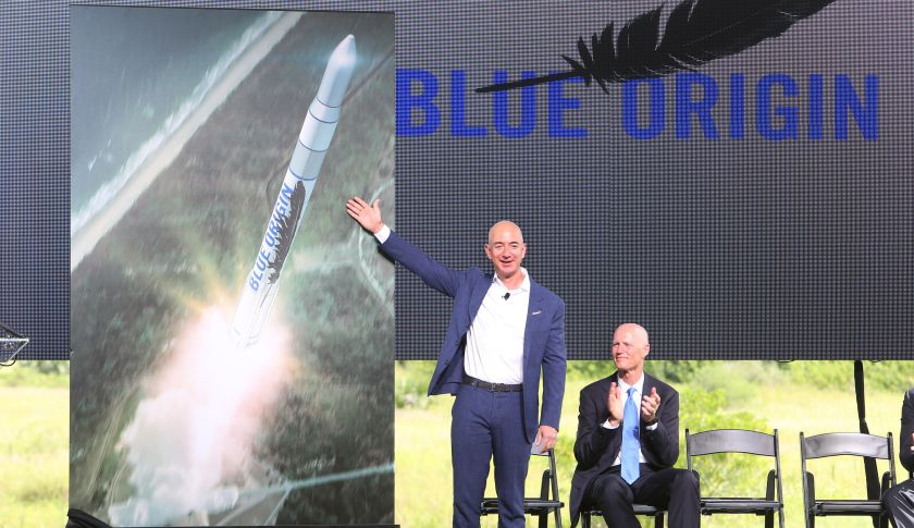 Amazon.com CEO and Blue Origin founder Jeff Bezos, left, debuts a launch vehicle on Tuesday, Sept. 15, 2015.