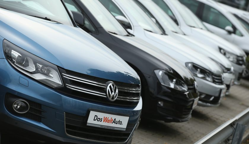 Used cars of German carmaker Volkswagen stand on display at a Volkswagen car dealership.