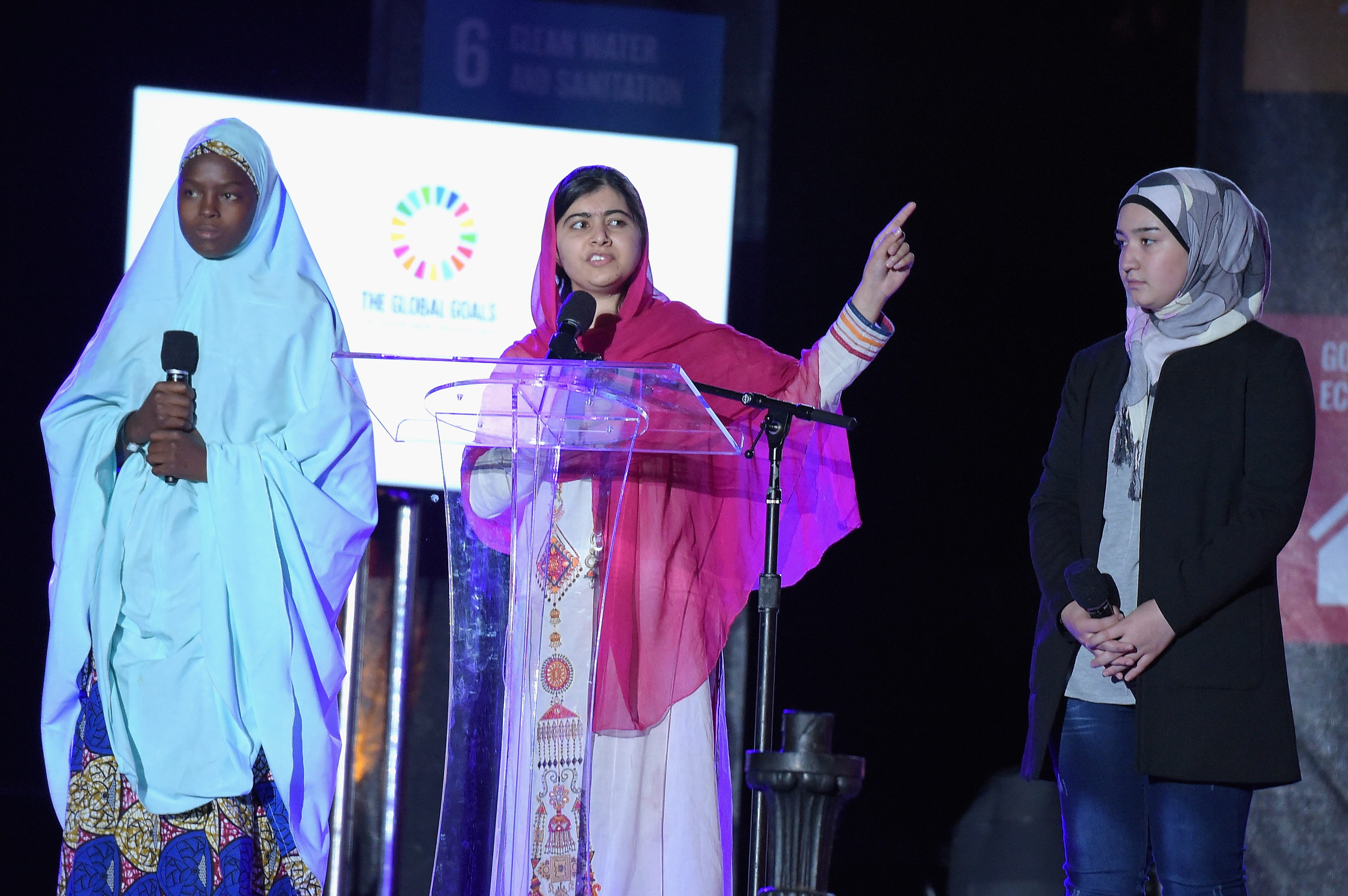 Activist Malala Yousafzai, center, speaks on stage at the 2015 Global Citizen Festival to end extreme poverty by 2030 in Central Park in New York City on Sept. 26, 2015