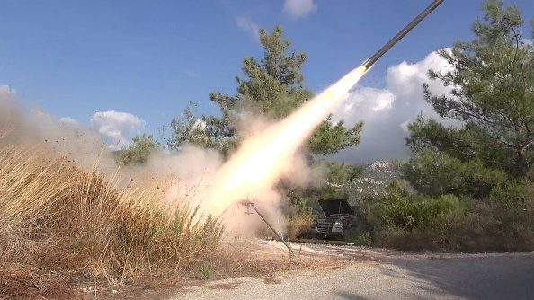 Syrian rebels fire a missile at the airbase being used by Russian aircraft at Lakatia Sept. 28.