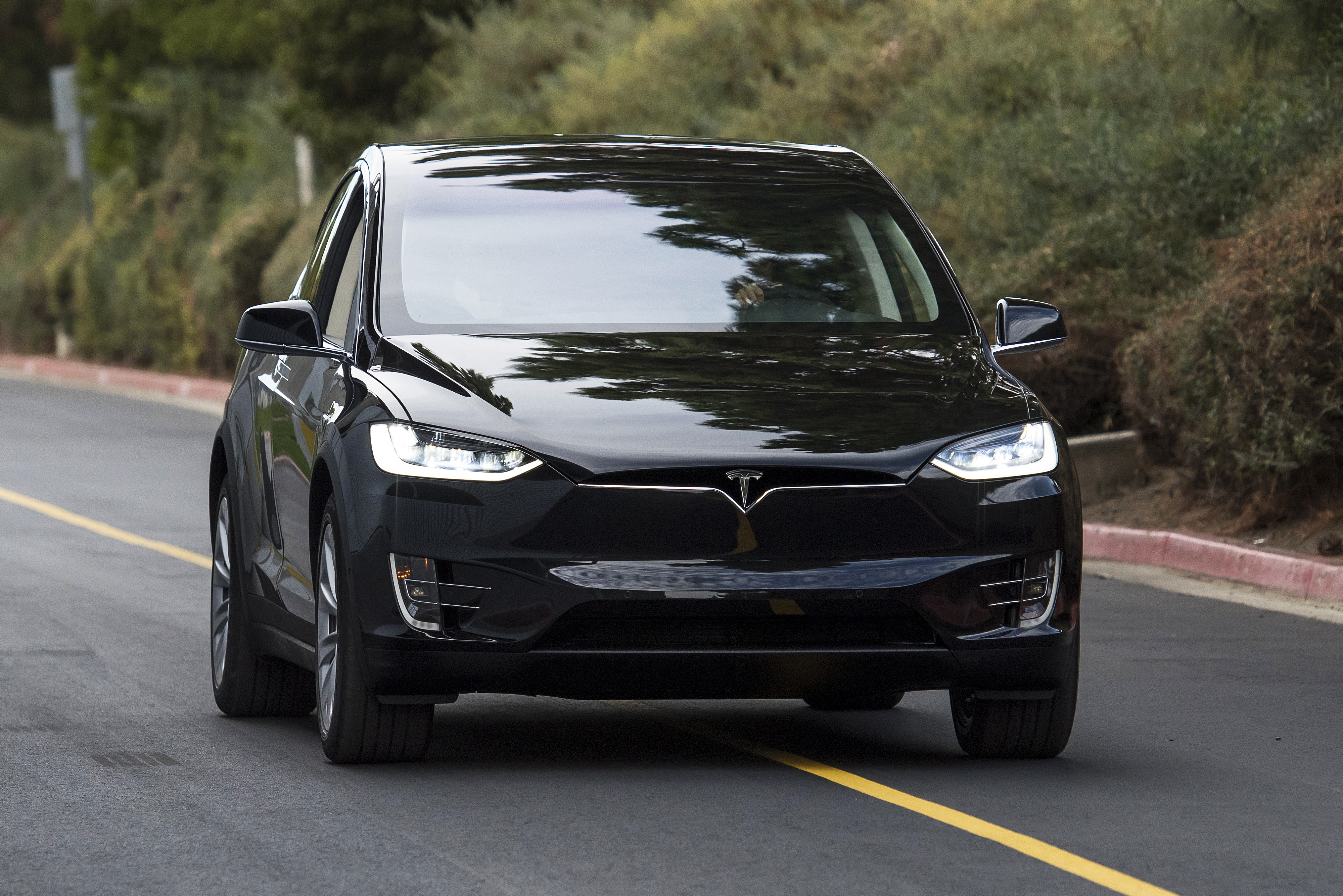 The Tesla Motors Inc. Model X sport utility vehicle (SUV) is driven during an event in Fremont, California, U.S., on Tuesday, Sept. 29, 2015.