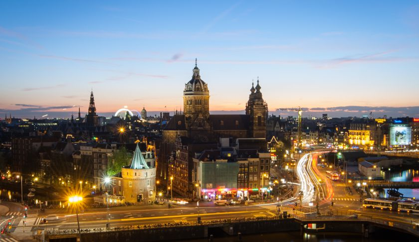 The city of Amsterdam in the Netherlands just after sunset.