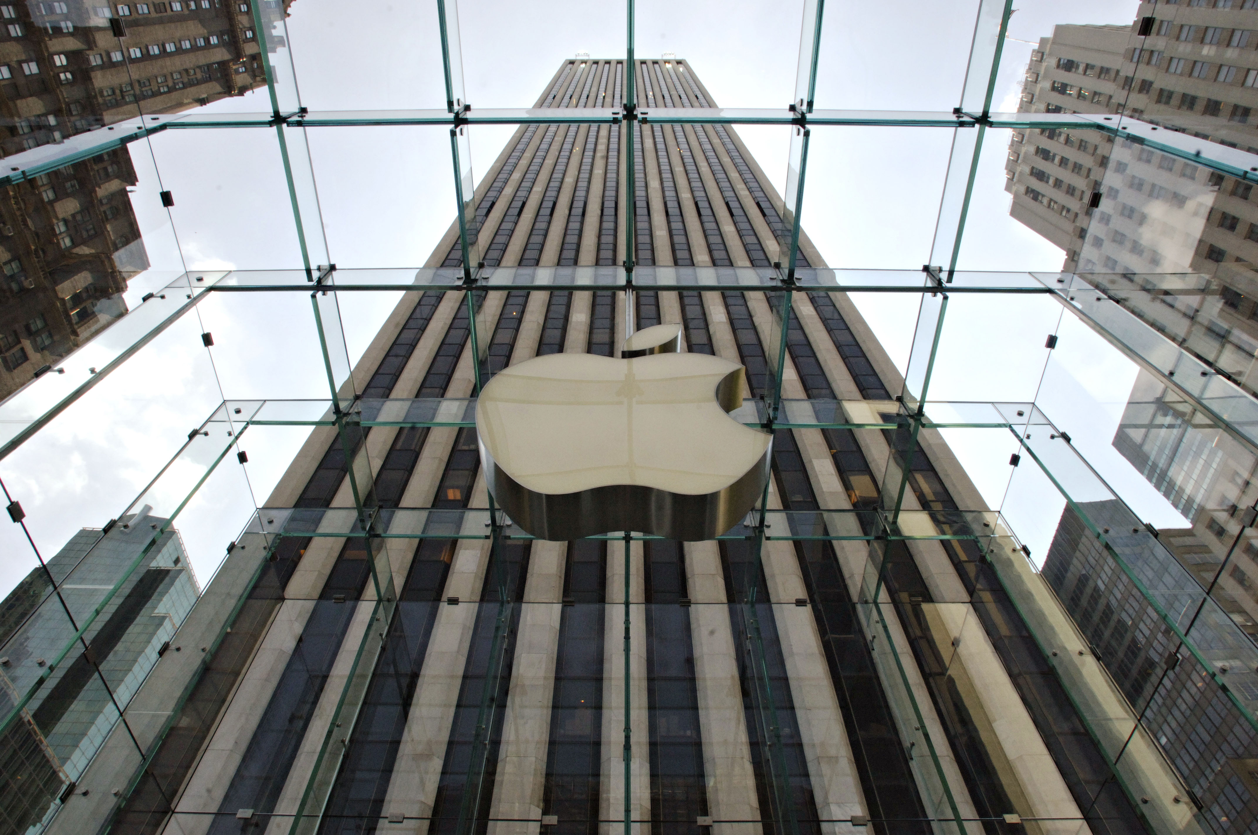 An Apple Computer Inc. logo hangs in the center of a clear glass cube marking the entrance to the new Apple Store in New York, Thursday, May 18, 2006.