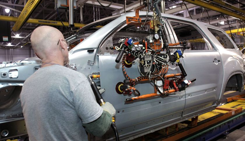 General Motors employees assemble a GM crossover SUV on the assembly line at the GM Lansing Delta Township Assembly Plant in Lansing, Mich.