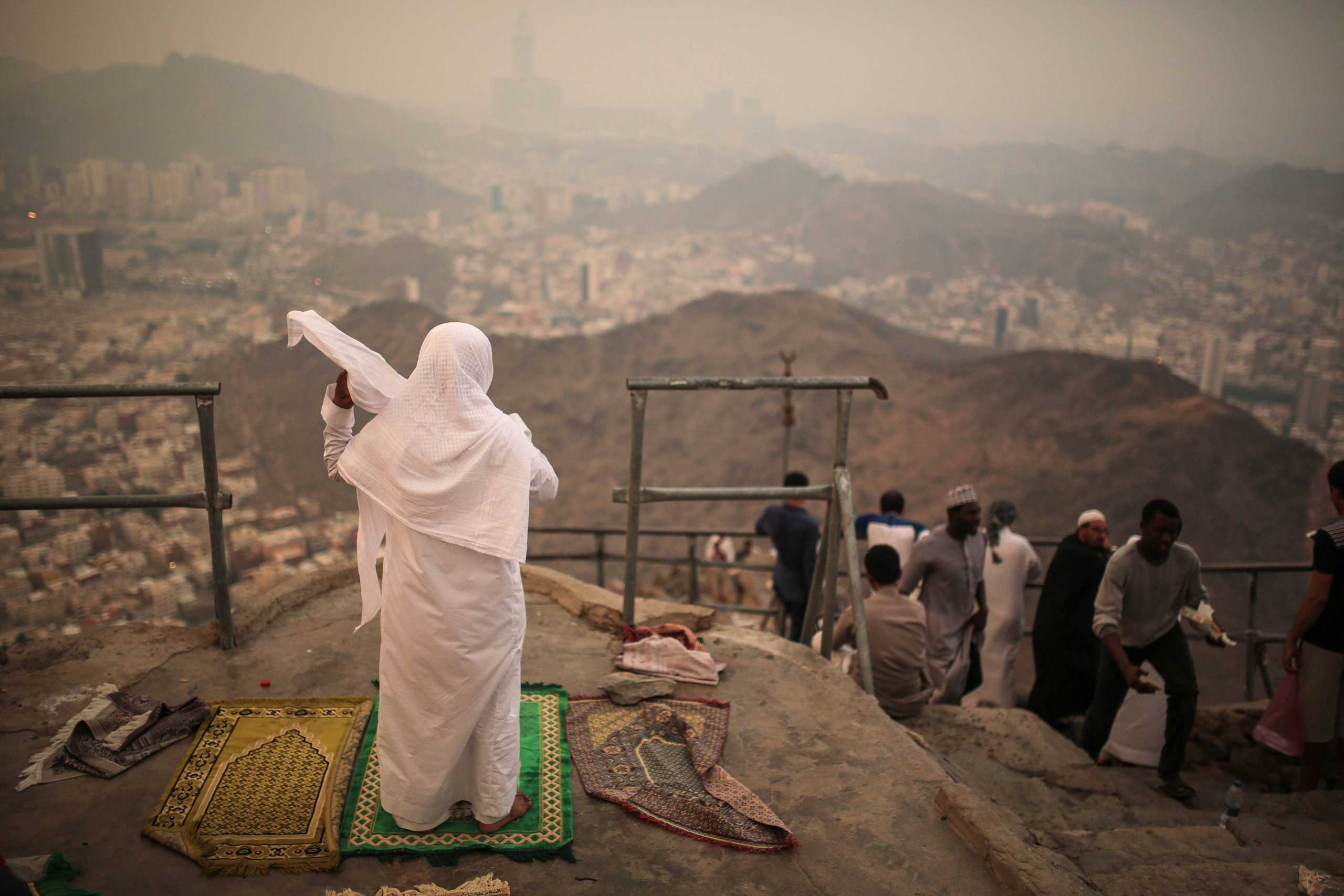 Muslim pilgrims pray atop the Noor Mountain outside the Hiraa cave, where Prophet Muhammad received his first revelation from God to preach Islam, on the outskirts of Mecca, on Sept. 18, 2015.