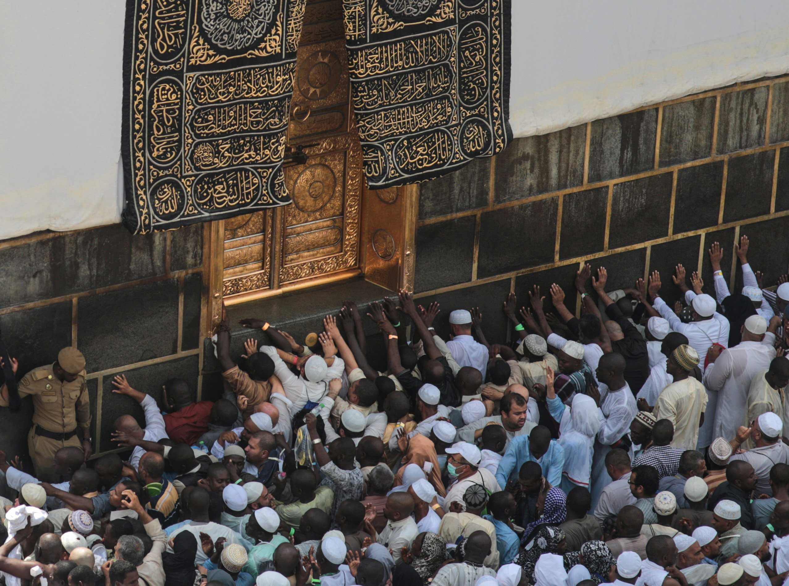 Muslim pilgrims pray at the Kaaba, the cubic building at the Grand Mosque in the Muslim holy city of Mecca, on Sept. 20, 2015.