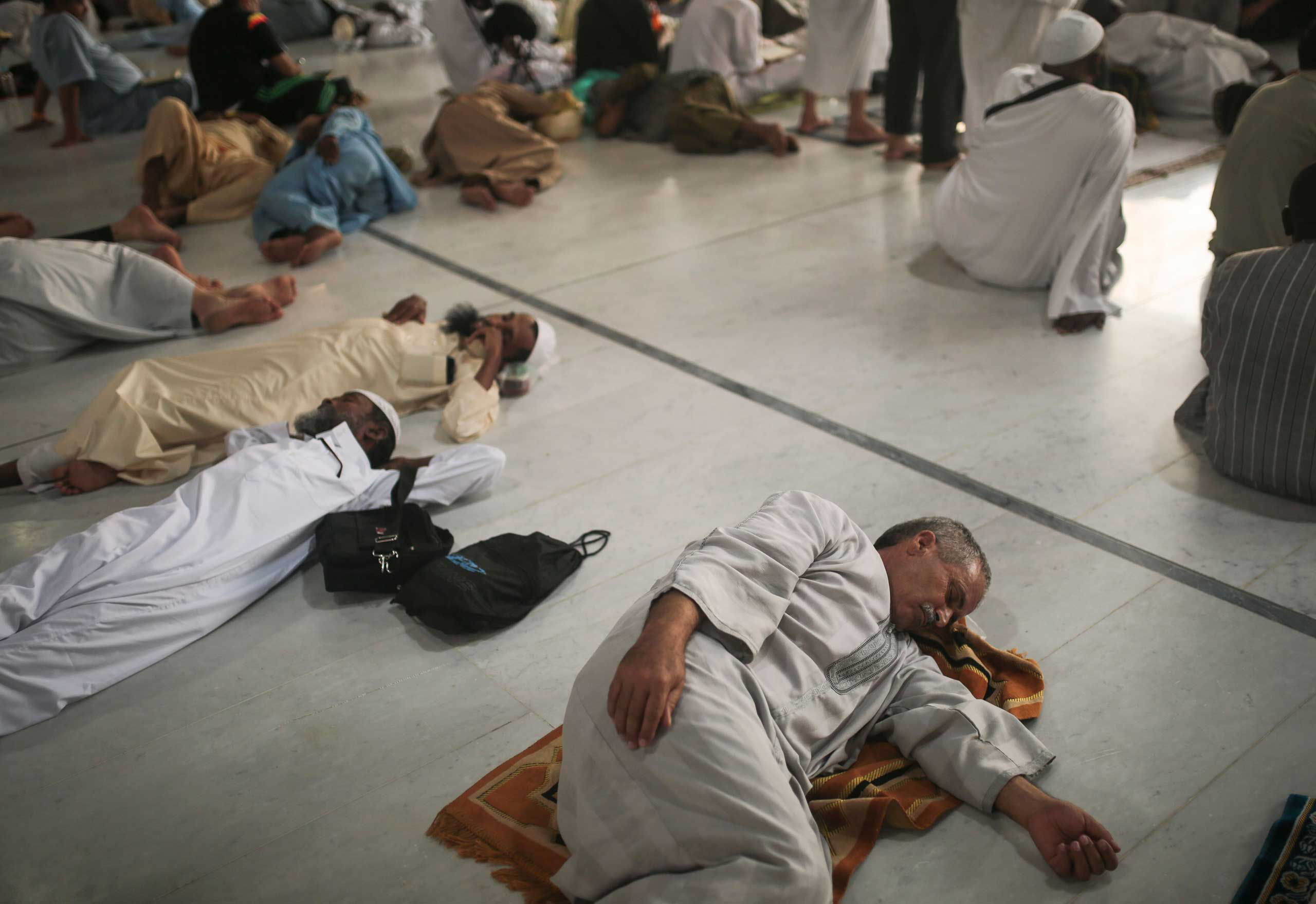 Muslim pilgrims rest inside the Grand Mosque in the holy city of Mecca, on Sept. 20, 2015.