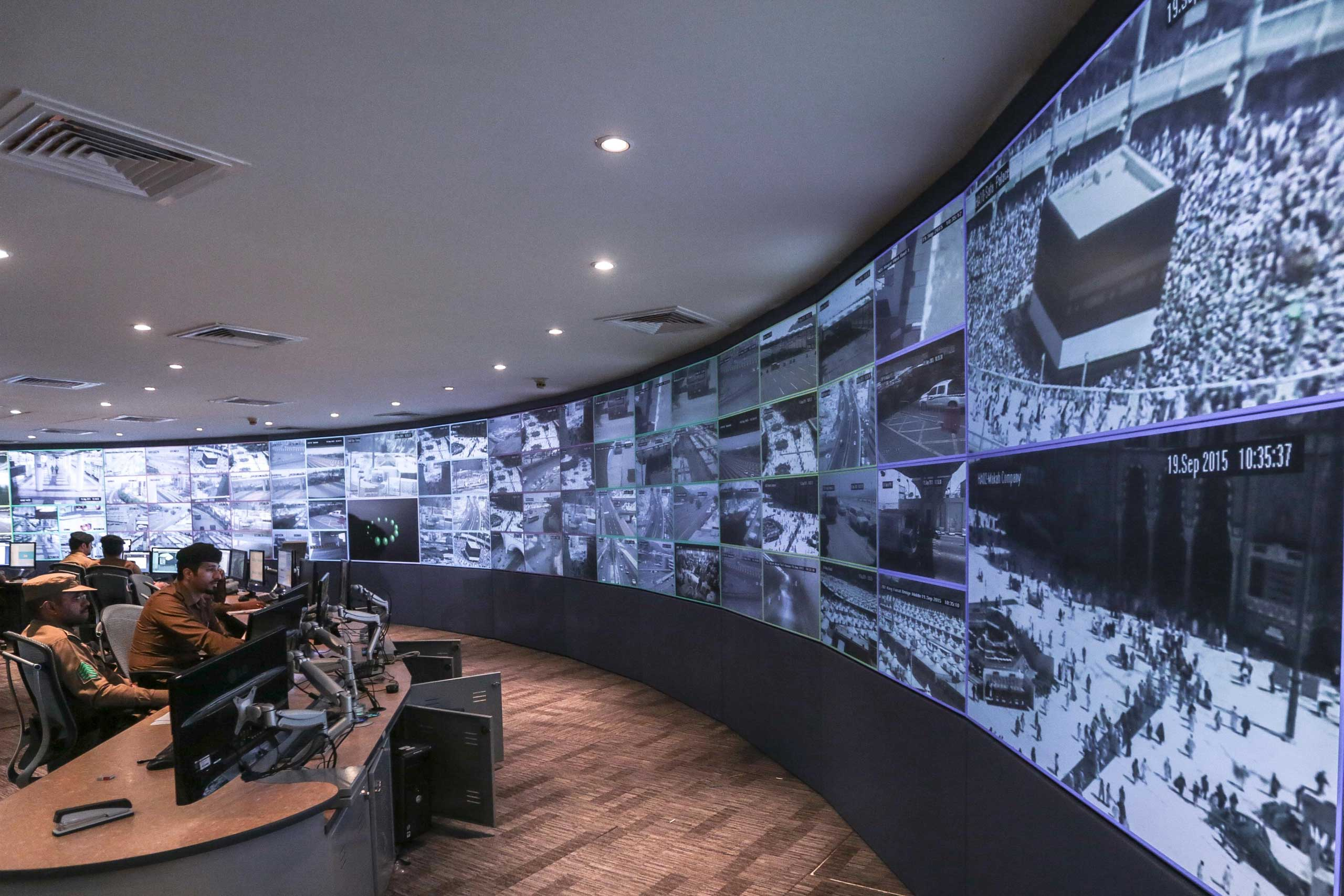 Saudi security officers monitor live feed screens showing Muslim pilgrims in the holy city of Mecca, along with highways and high density areas, a few days before the annual pilgrimage, known as the hajj, in Mecca, on Sept. 19, 2015.