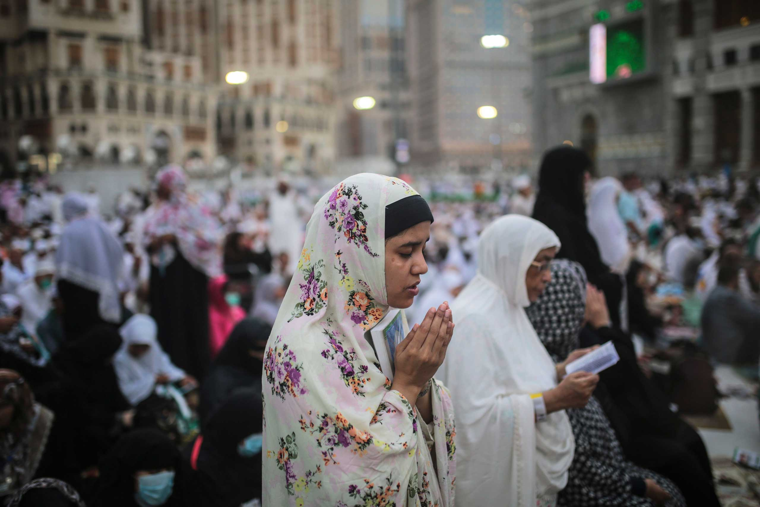 A Muslim Pilgrim prays outside the Grand Mosque in the holy city of Mecca, on Sept. 20, 2015.