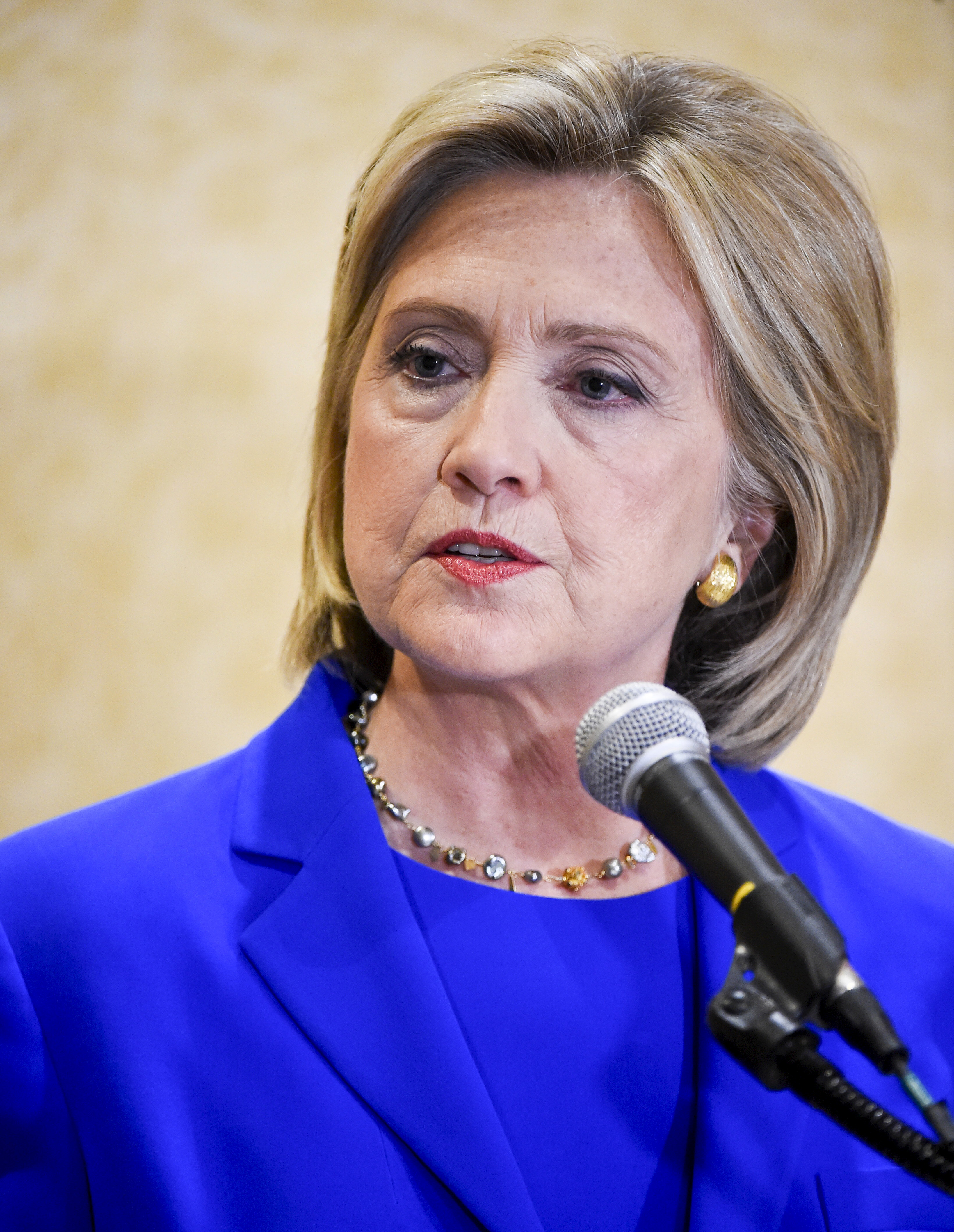Democratic presidential candidate Hillary Clinton takes reporters questions during a news conference after she addressed the Democratic National Committee (DNC) Summer Meeting in Minneapolis on Aug. 28, 2015.