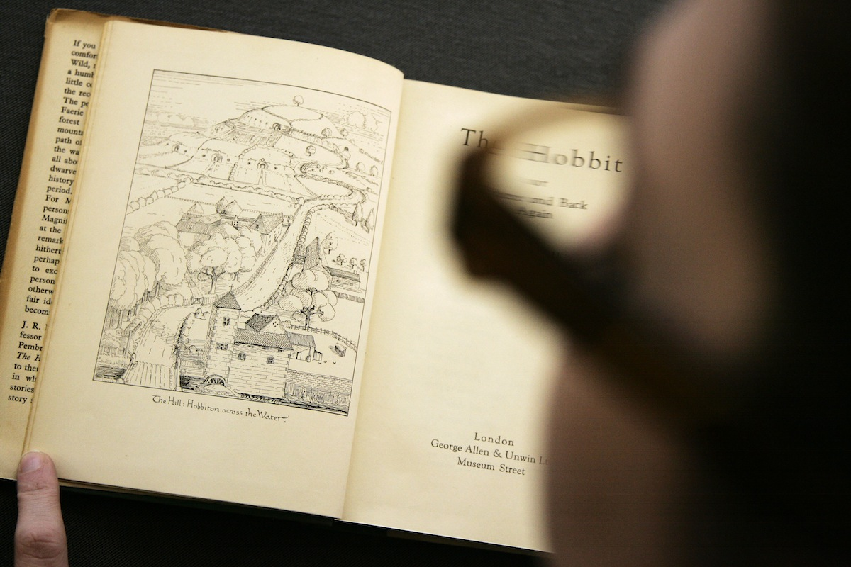 A Bonhams employee examines a copy of the 1937 first issue of the first edition of 'The Hobbit' by author J.R.R. Tolkien on display at the auction house in London, in March 17, 2008. That copy went on to set a new world record price at auction for an inscribed copy of the book.
