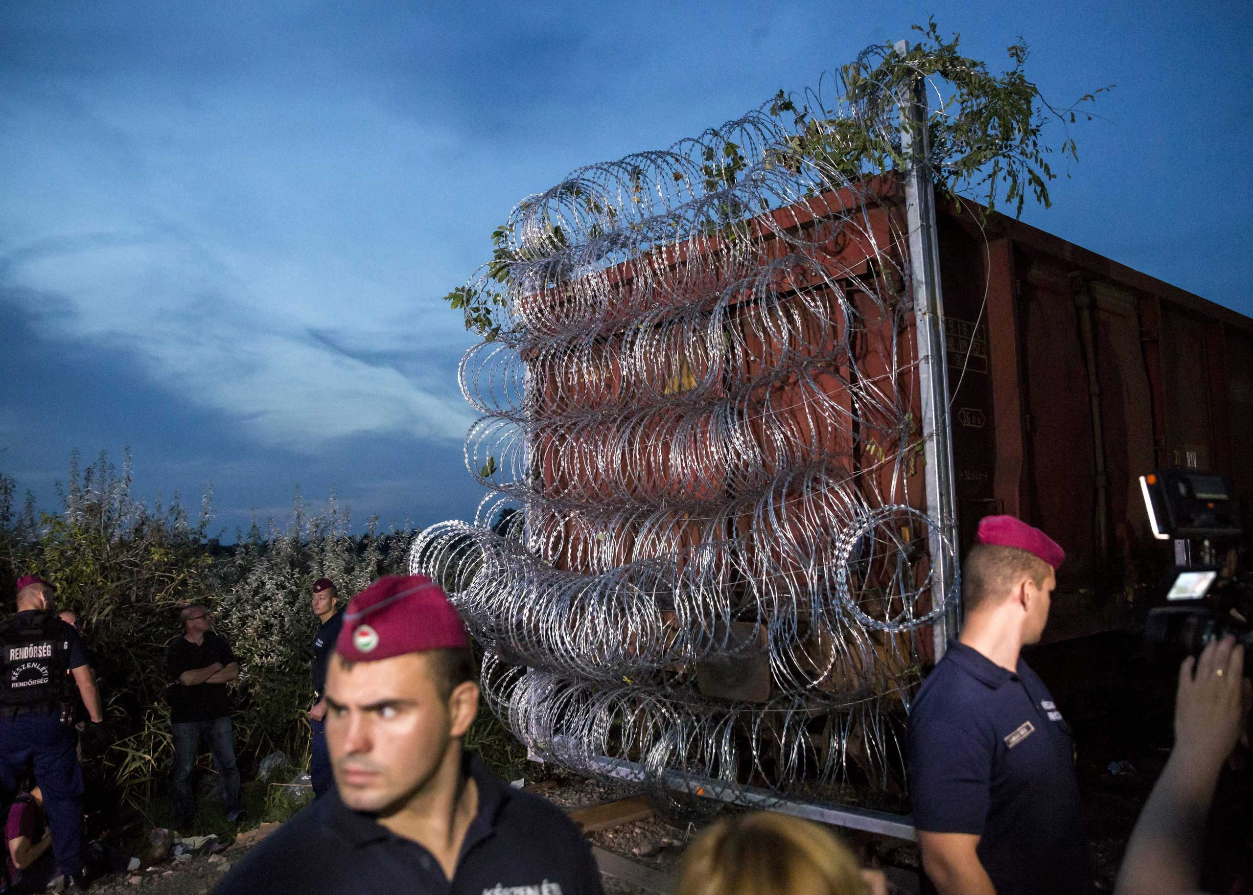 A wagon equipped with razor wire is placed at the border between Hungary and Serbia in Roszke, some 10 miles southeast from Budapest, Hungary, Sept. 14, 2015, to close the gap of the temporary border fence at the Horgos-Szeged railway line.