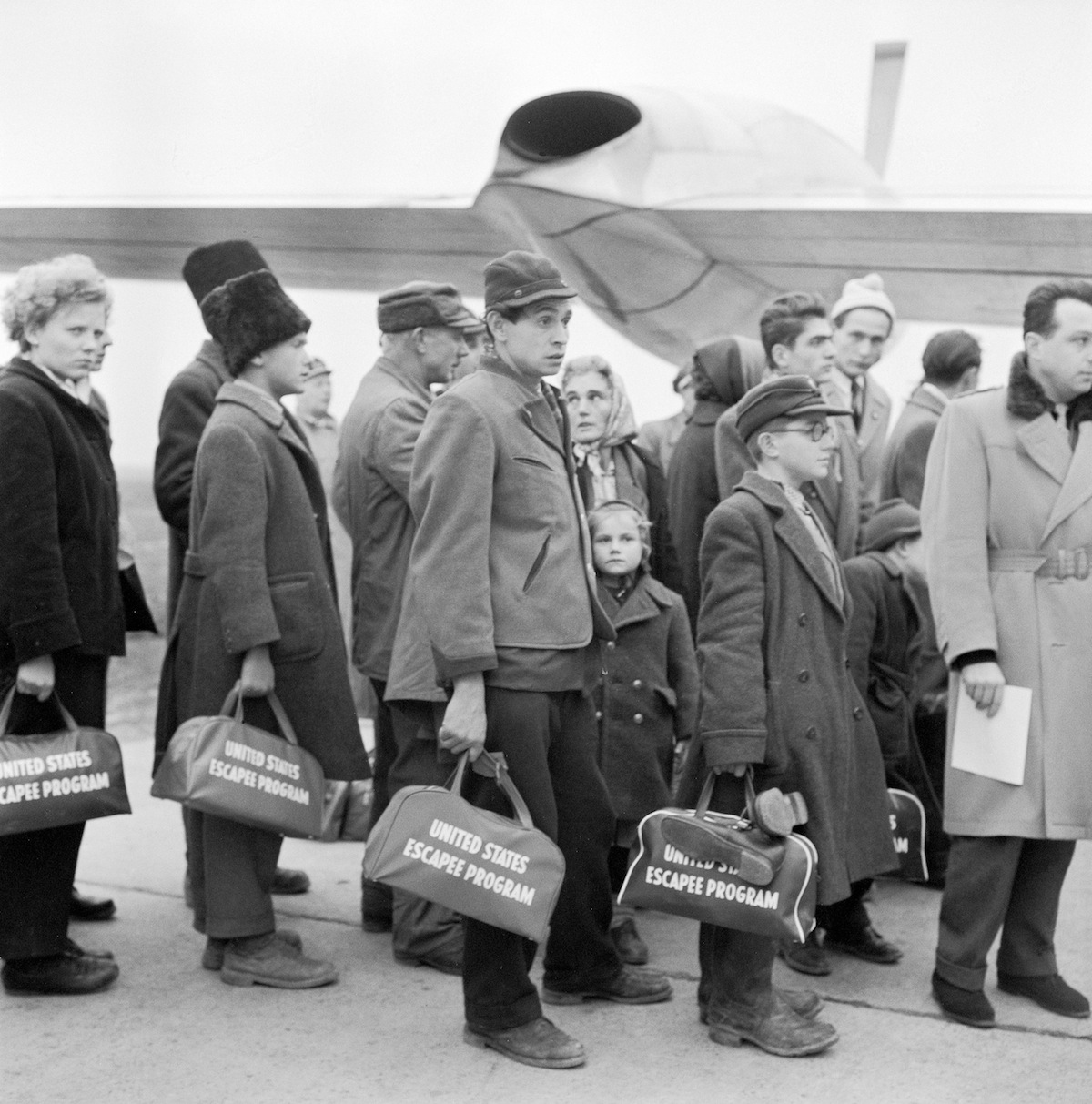 Hungarian refugees bording the plane for America at Schwechat Airport. Austria, 1956.