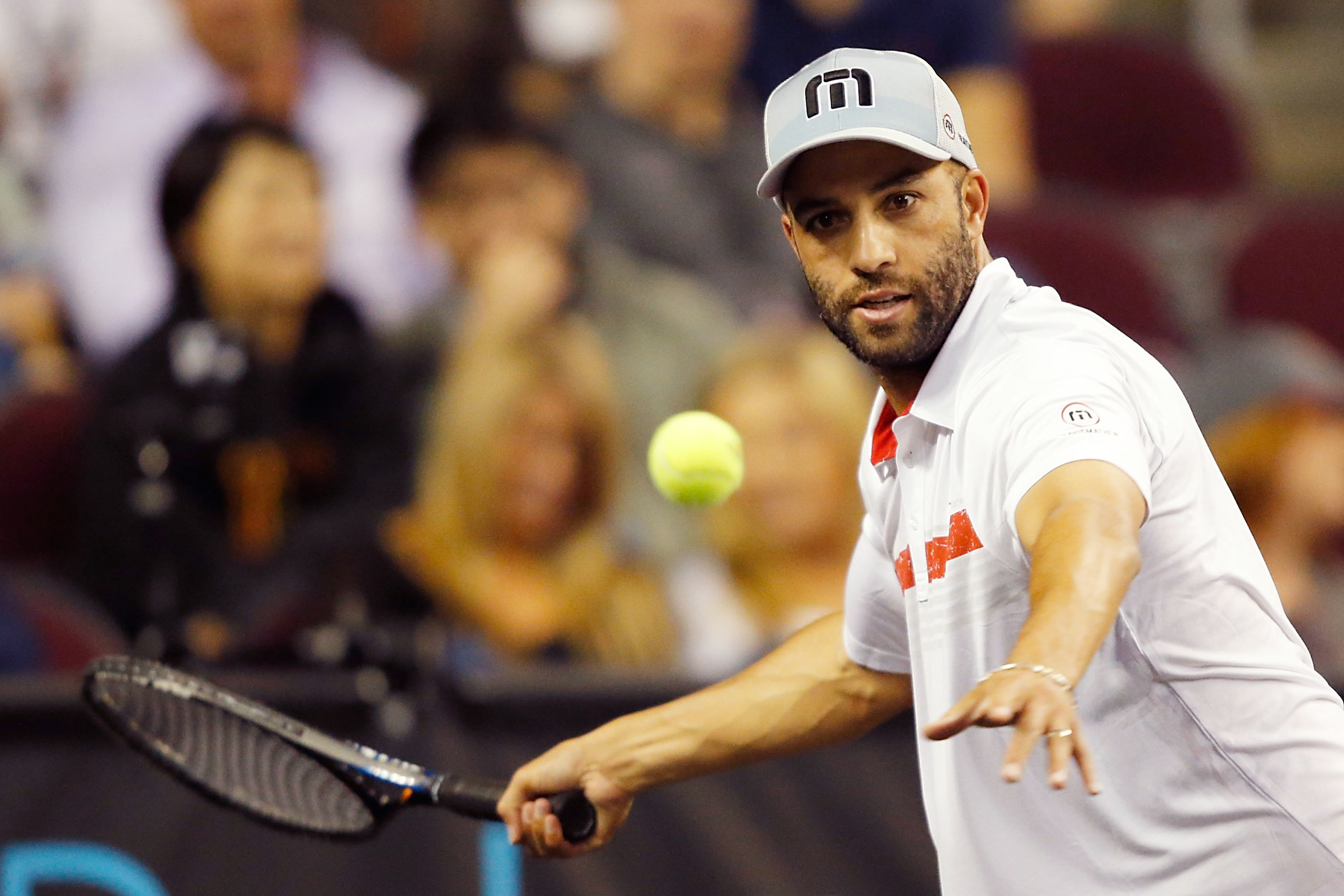 James Blake returns a shot to Andy Roddick during the PowerShares Series SoCal Honda Dealers Helpful Cup at Galen Center on March 25, 2015 .