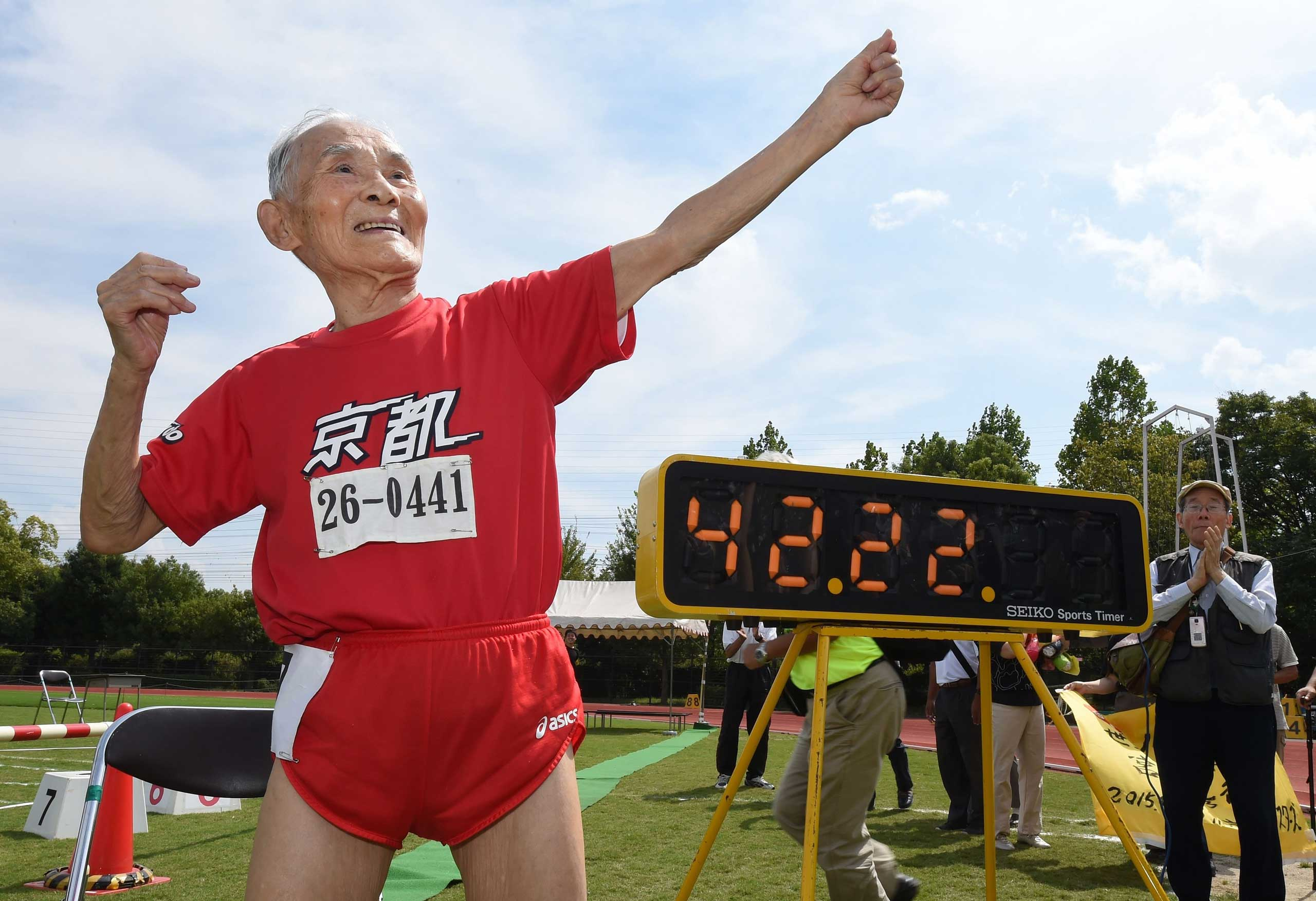 Hidekichi Miyazaki, 105, imitates the pose of Usain Bolt after running with other competitors over eighty years of age during a 100-metre-dash in the Kyoto Masters Autumn Competiton in Kyoto, western Japan, on Sept. 23, 2015.