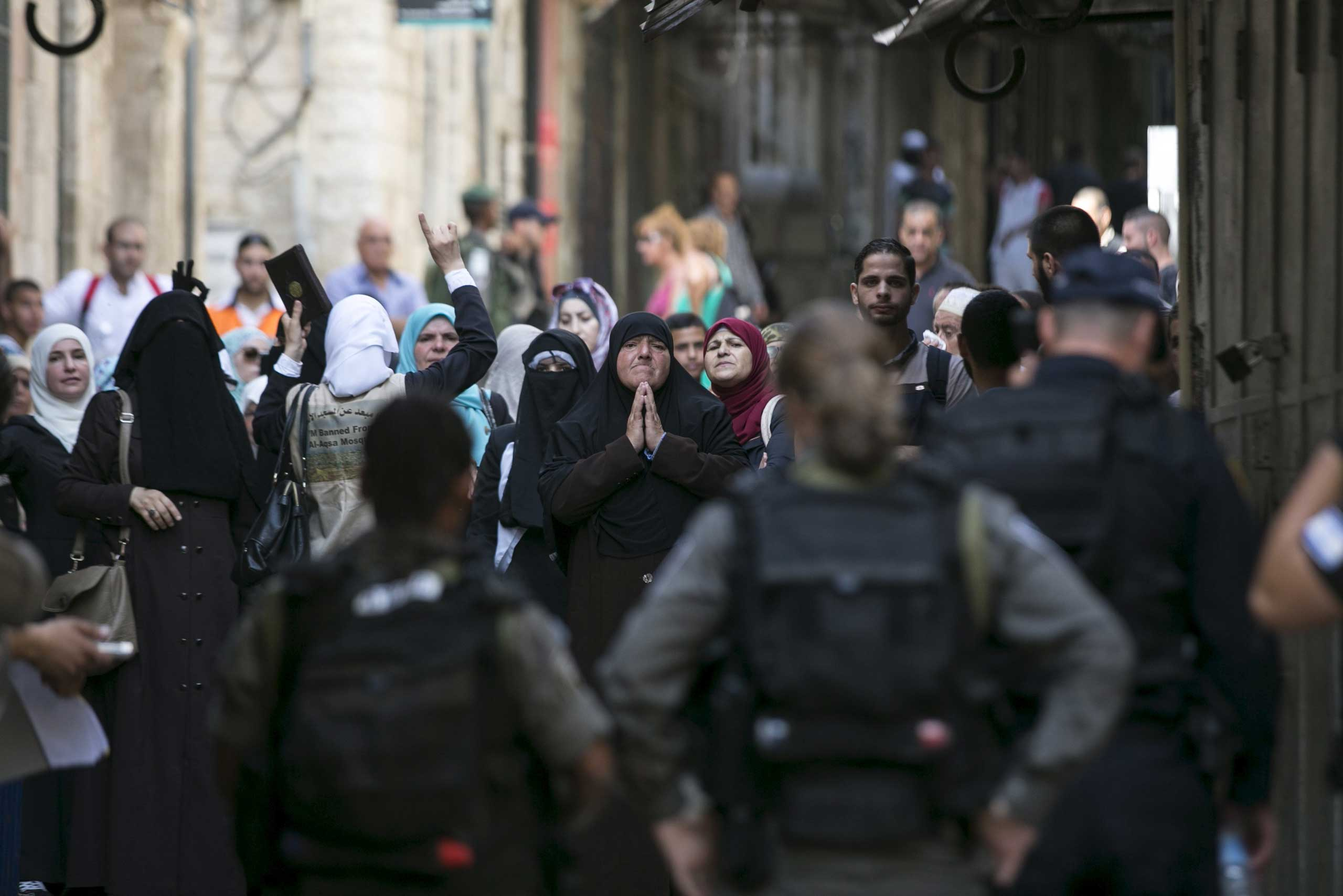 Muslim women shouts slogans as they protest in front of Israeli border police officers in Jerusalem's Old City, on Sept. 15, 2015.