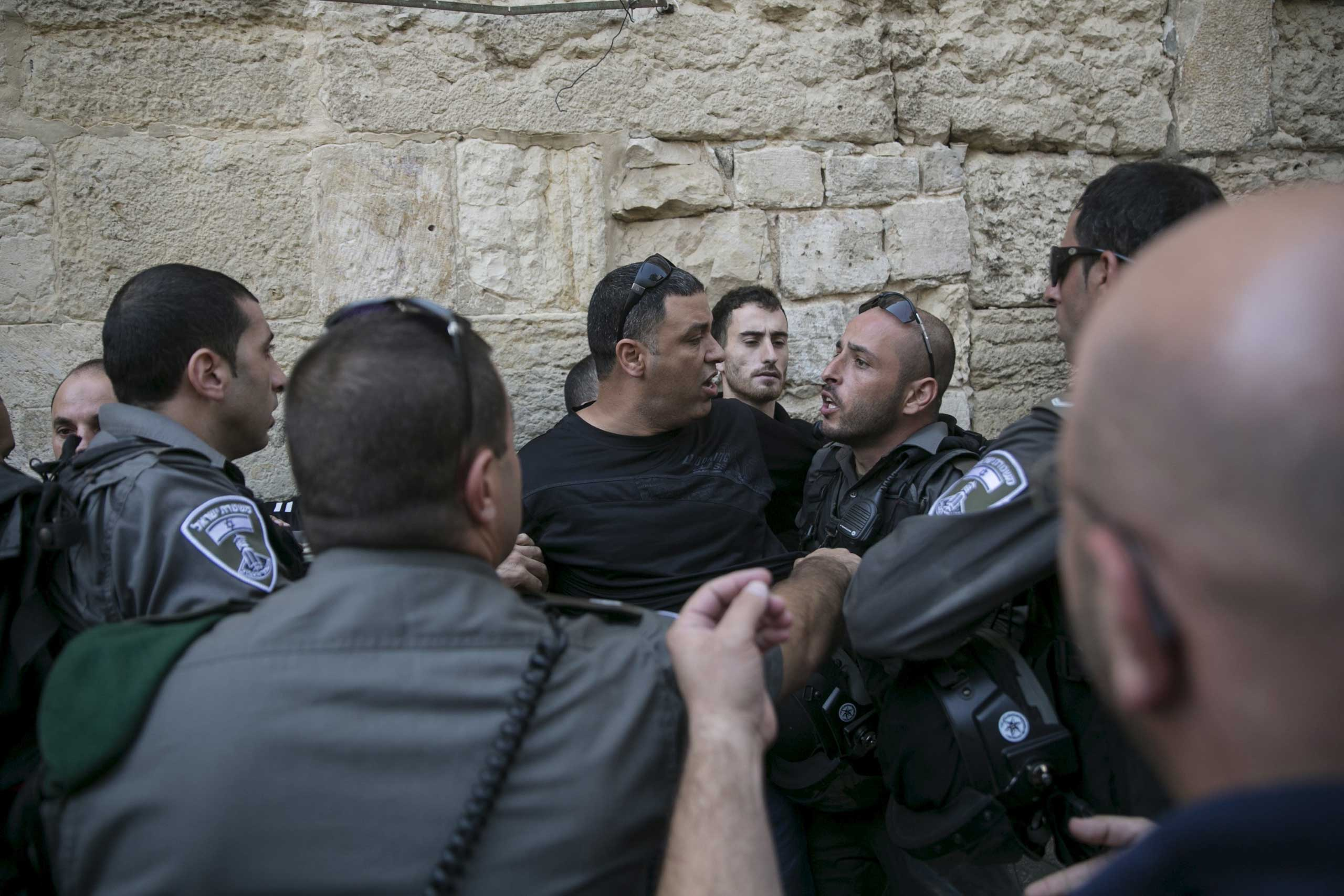 Israeli border police officers detain a Palestinian protester in Jerusalem's Old City, on Sept. 15, 2015.