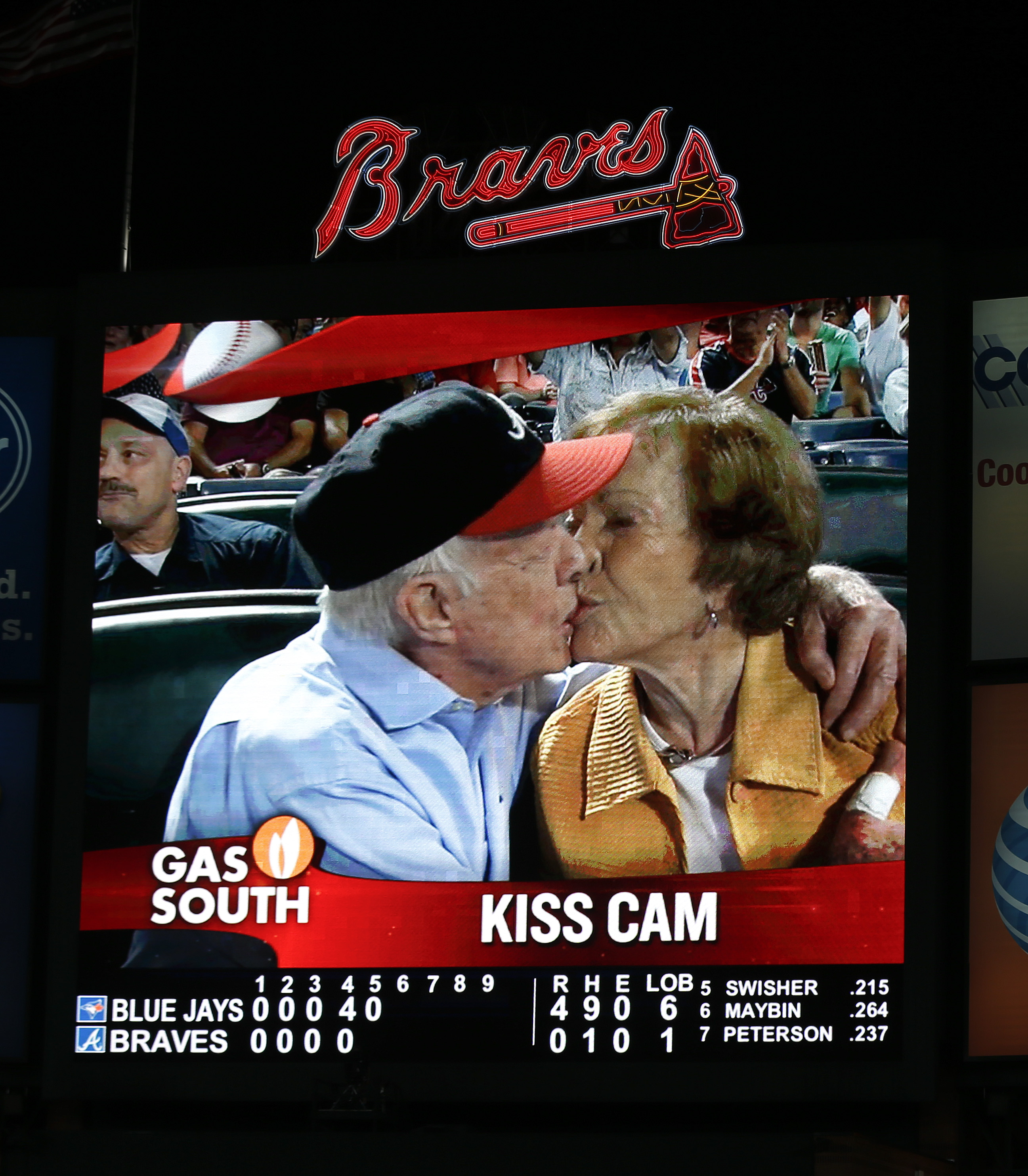 Jimmy Carter kisses his wife, Rosalynn, on the  Kiss Cam  during a baseball game between the Atlanta Braves and the Toronto Blue Jays in Atlanta on Sept. 17, 2015.