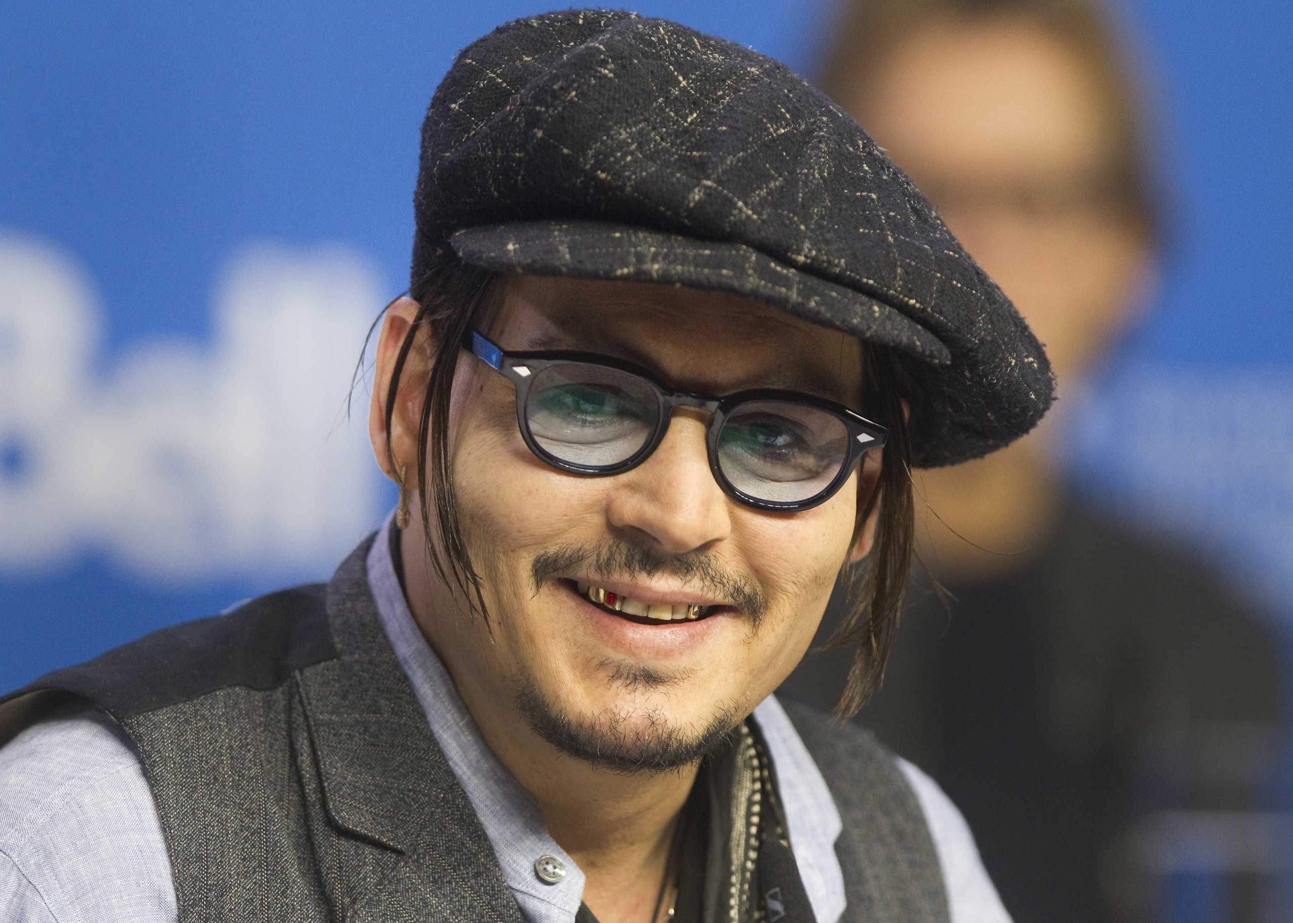 Johnny Depp attends a news conference to promote the film  Black Mass  at TIFF the Toronto International Film Festival in Toronto, Sept. 14, 2015.
