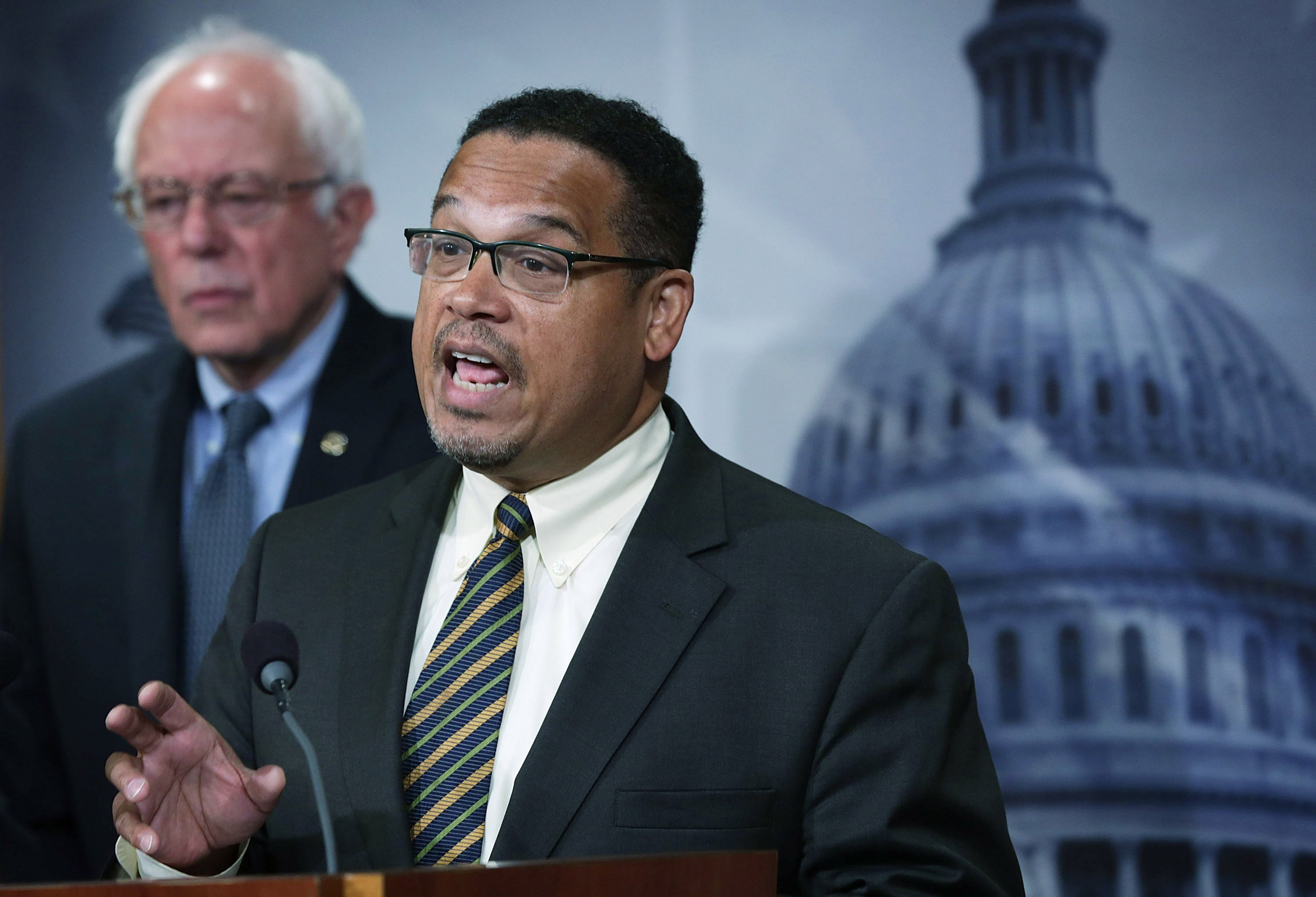 Sen. Bernie Sanders and Rep. Keith Ellison speak to members of the media during a news conference about private prisons on Capitol Hill in Washington on Sept. 17, 2015.