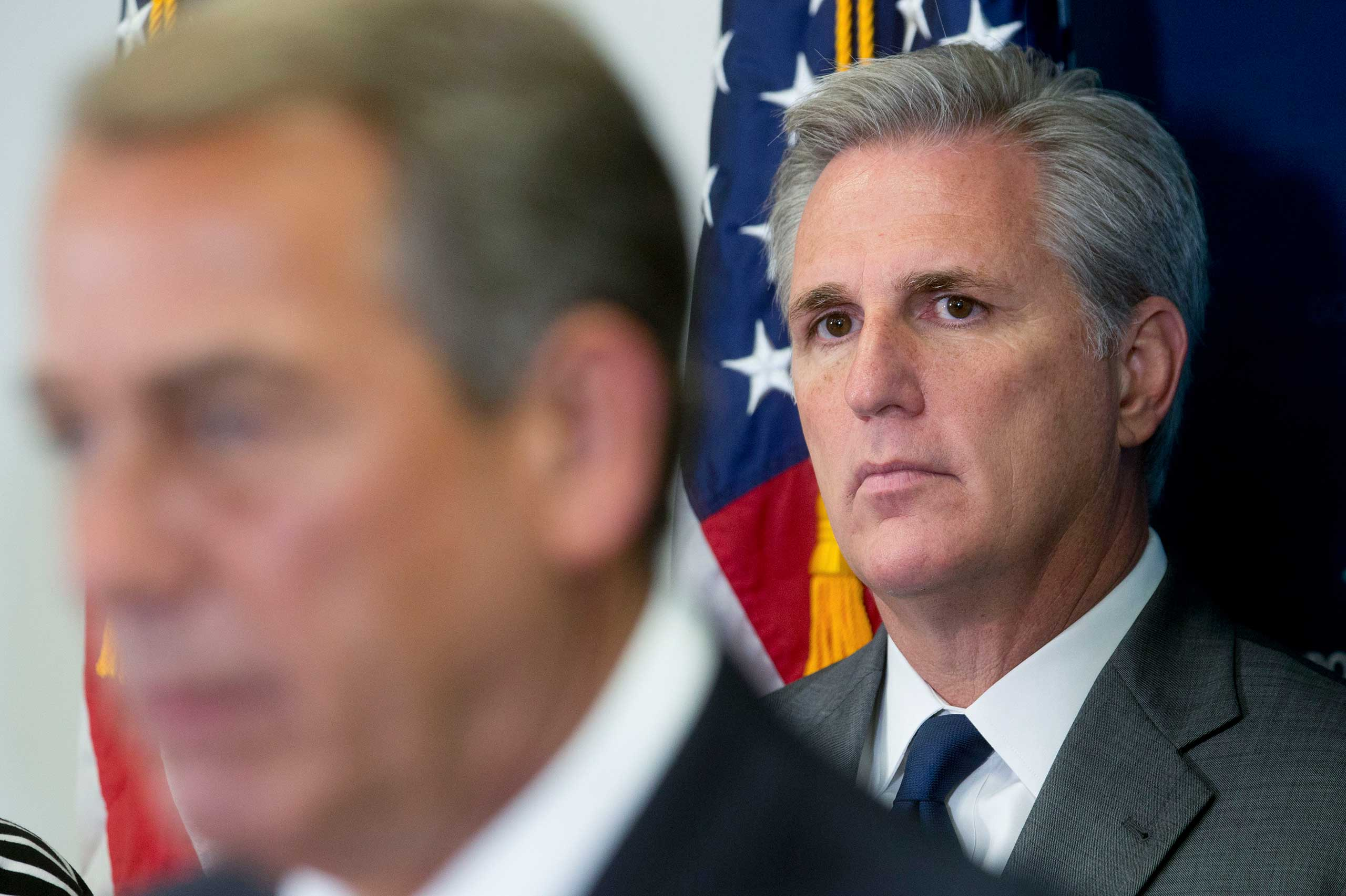 House Majority Leader Kevin McCarthy, a Republican from California, right, looks on as U.S. House Speaker John Boehner, a Republican from Ohio, speaks.