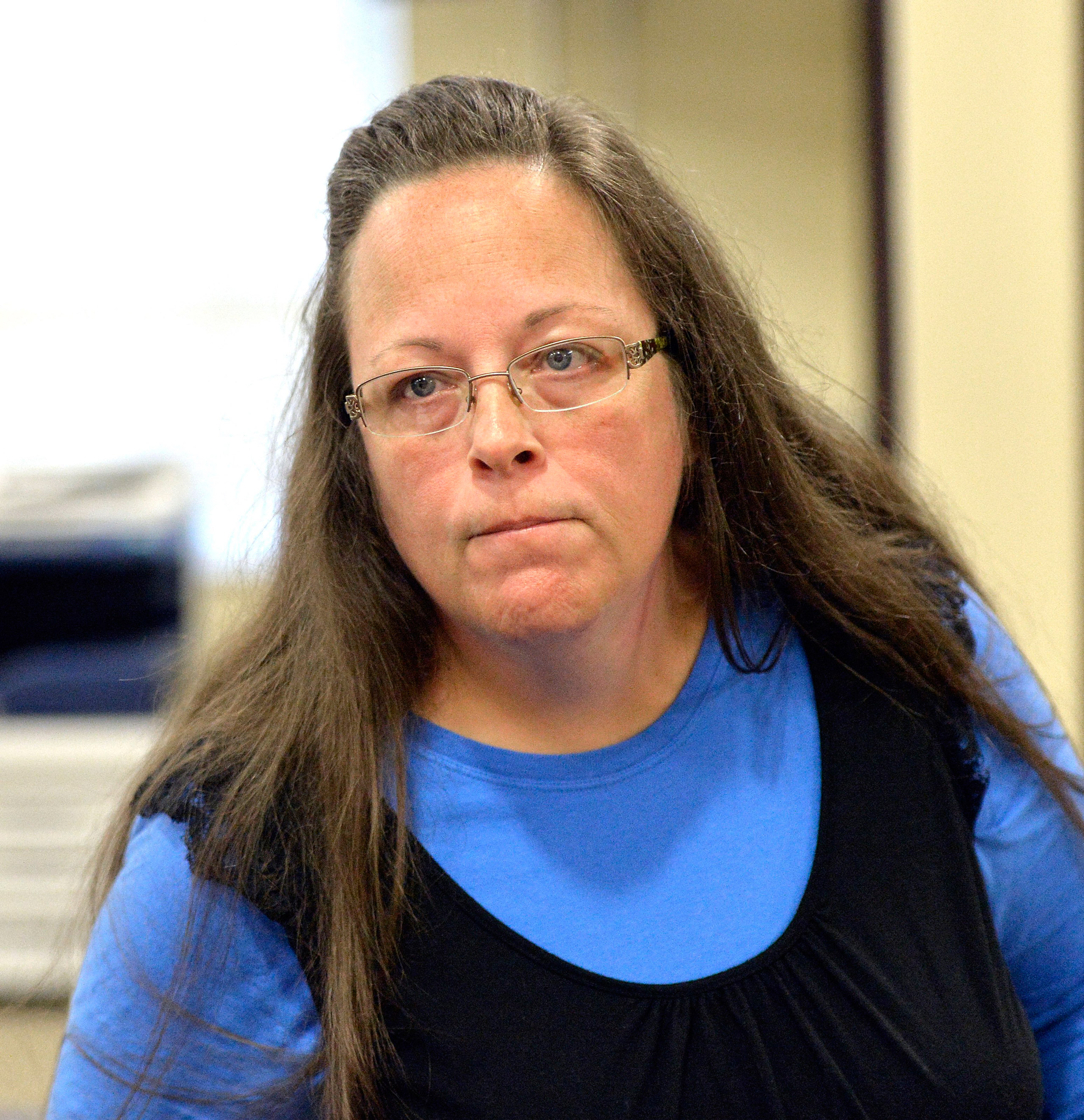 Rowan County Clerk Kim Davis listens to a customer following her office's refusal to issue marriage licenses at the Rowan County Courthouse in Morehead, Ky., on Sept. 1, 2015.