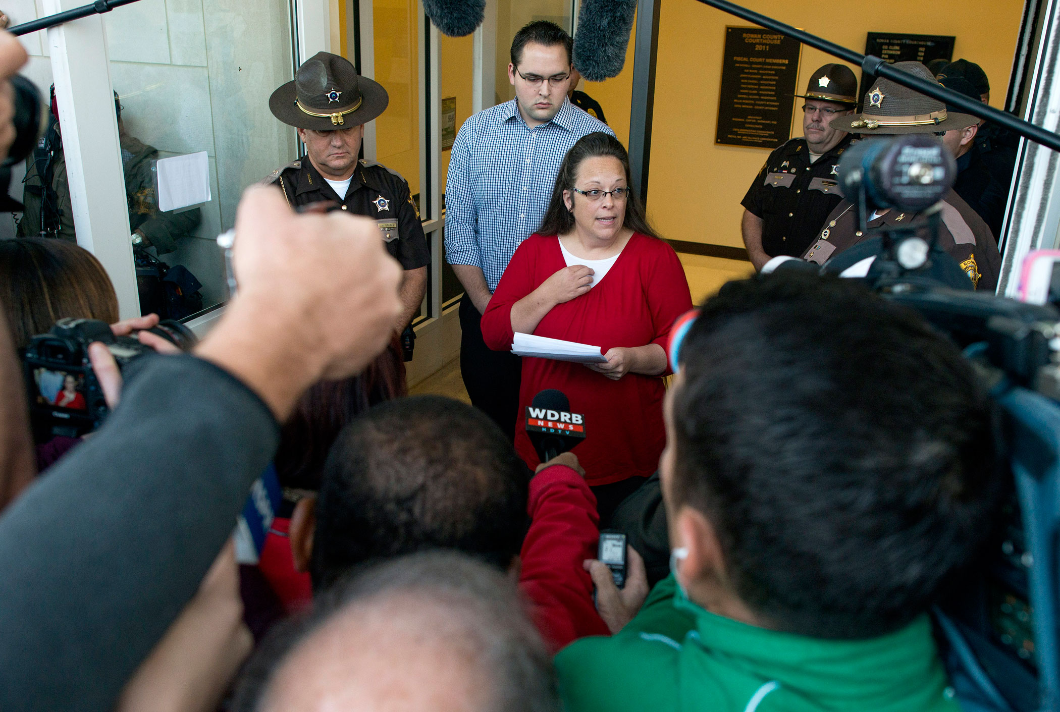 Rowan County clerk Kim Davis gives a statement  about  her intentions on applying her signature to same sex marriage licenses on her first day back to work, after being released from jail last week, at the Rowan County Courthouse on Sept. 14, 2015 in Morehead, Ky.