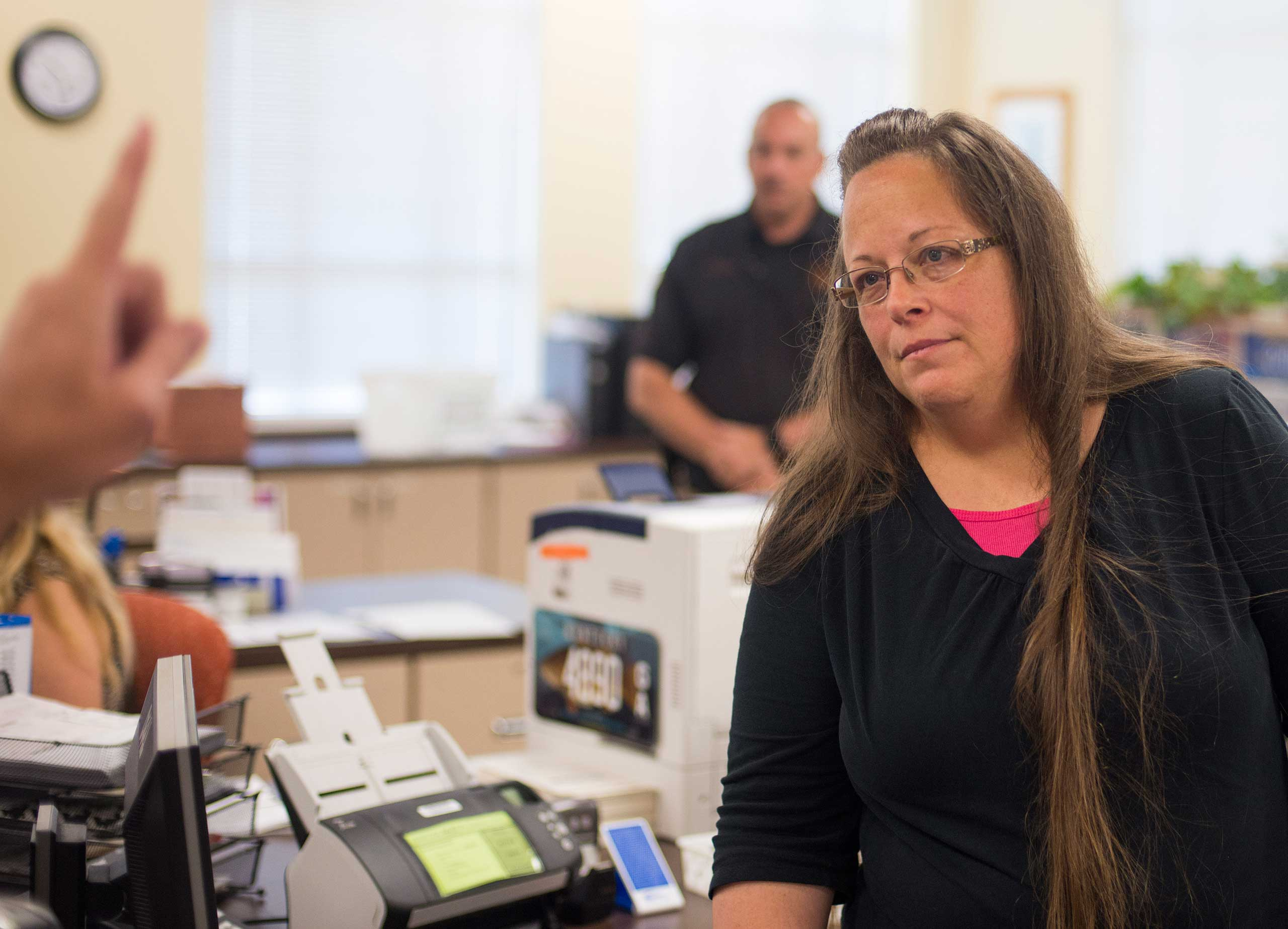 Kim Davis, the Rowan County Clerk of Courts, listens to Robbie Blankenship and Jesse Cruz as they speak with her about getting a marriage license at the County Clerks Office on Sept. 2, 2015 in Morehead, Ky.