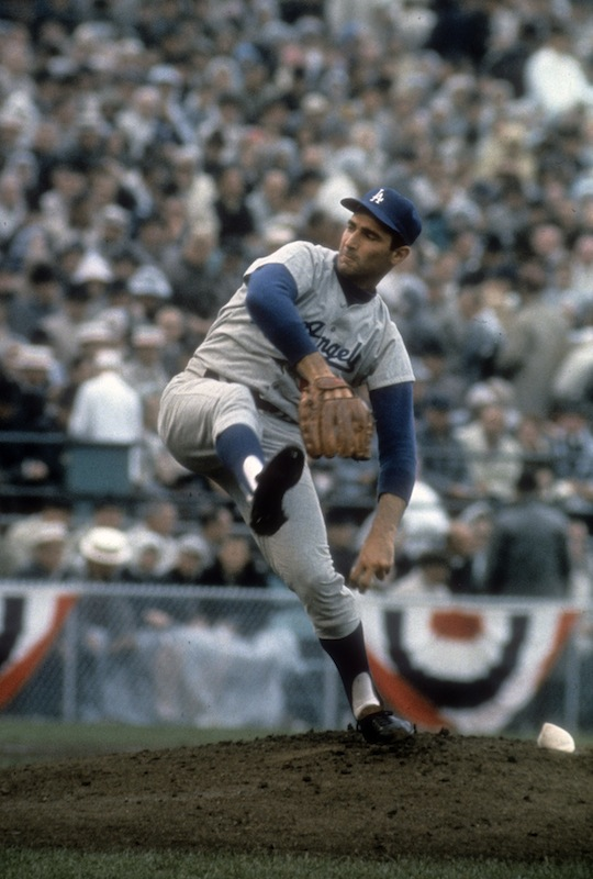 Pitcher Sandy Koufax of the Los Angeles Dodgers pitches against the Minnesota Twin in game 7 of the 1965 World Series, Oct. 14, 1965 at Metropolitan Stadium in Minneapolis.