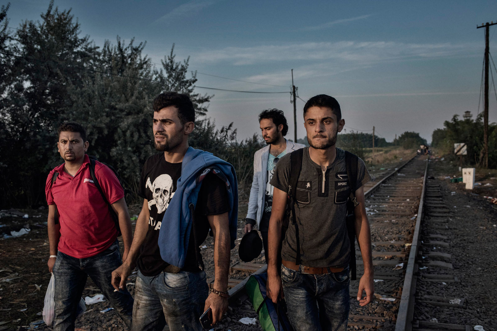 A group of migrants from Syria prepares to cross into the European Union through the border between Serbia and Hungary. Roszke, Hungary, Aug. 29, 2015.