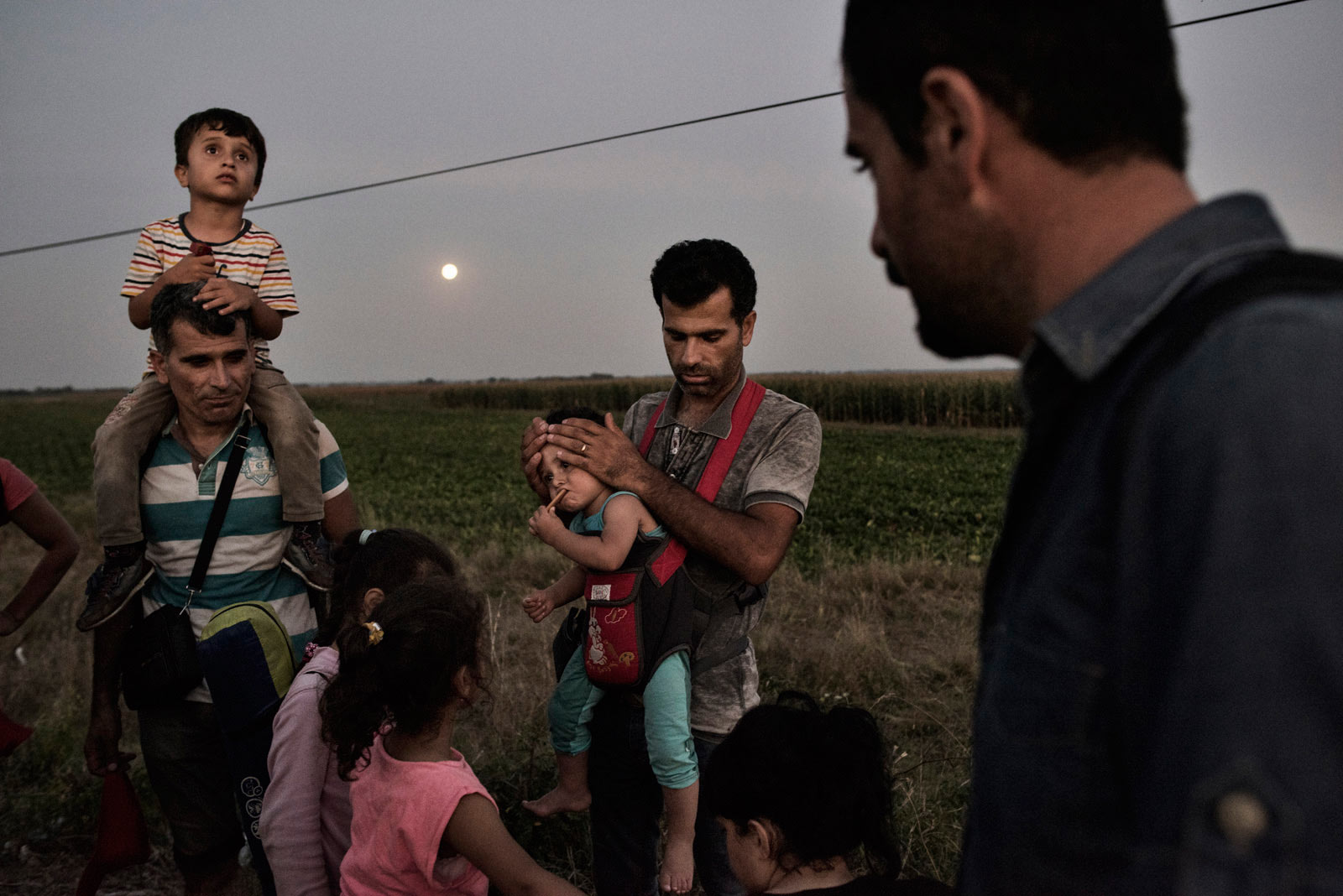 A Syrian family prepares to turn themselves into a Hungarian detention facility for migrants arriving in the European Union.                               Roszke, Hungary, Aug. 29, 2015.