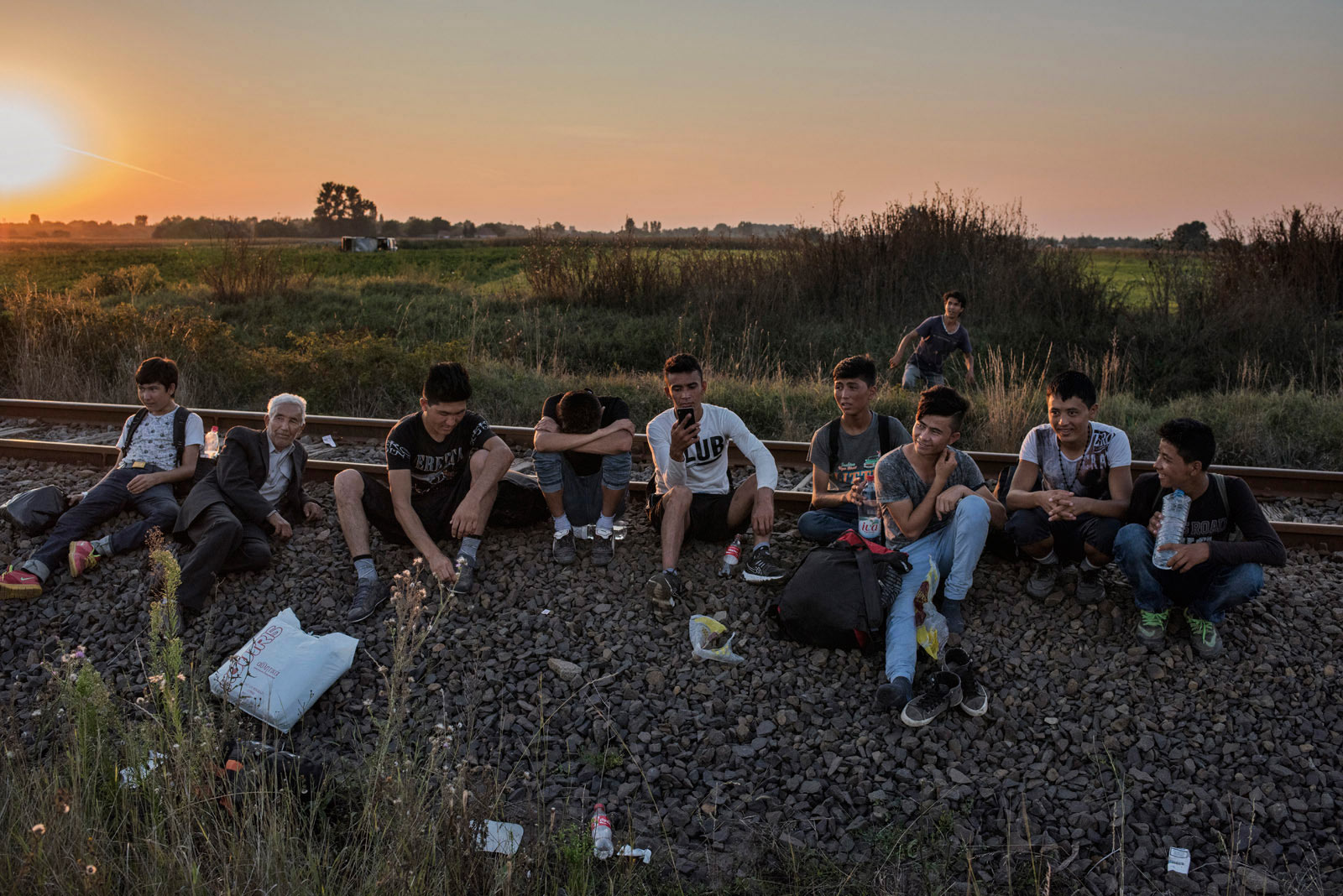 A group of migrants from Afghanistan takes a rest before crossing into the European Union through the border between Serbia and Hungary.                                Roszke, Hungary, Aug. 31, 2015.