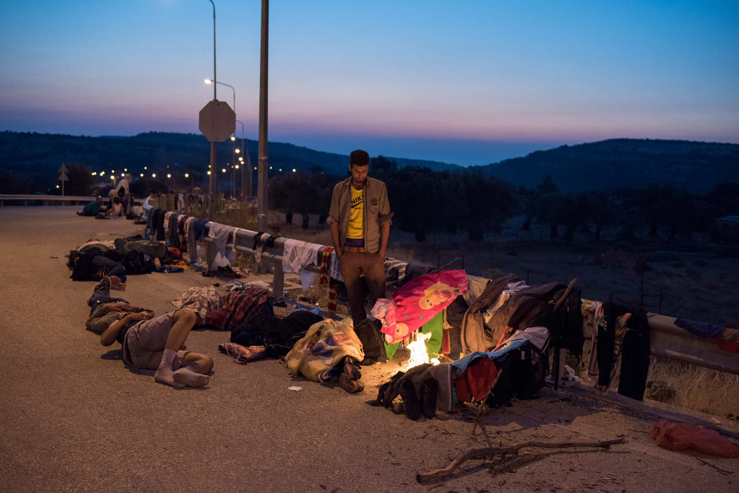 Migrants form a camp to rest on the roadside on the island of Lesbos, Greece, after coming ashore from Turkey on overcrowded rubber boats. Lesbos, Greece, Sept. 4, 2015.