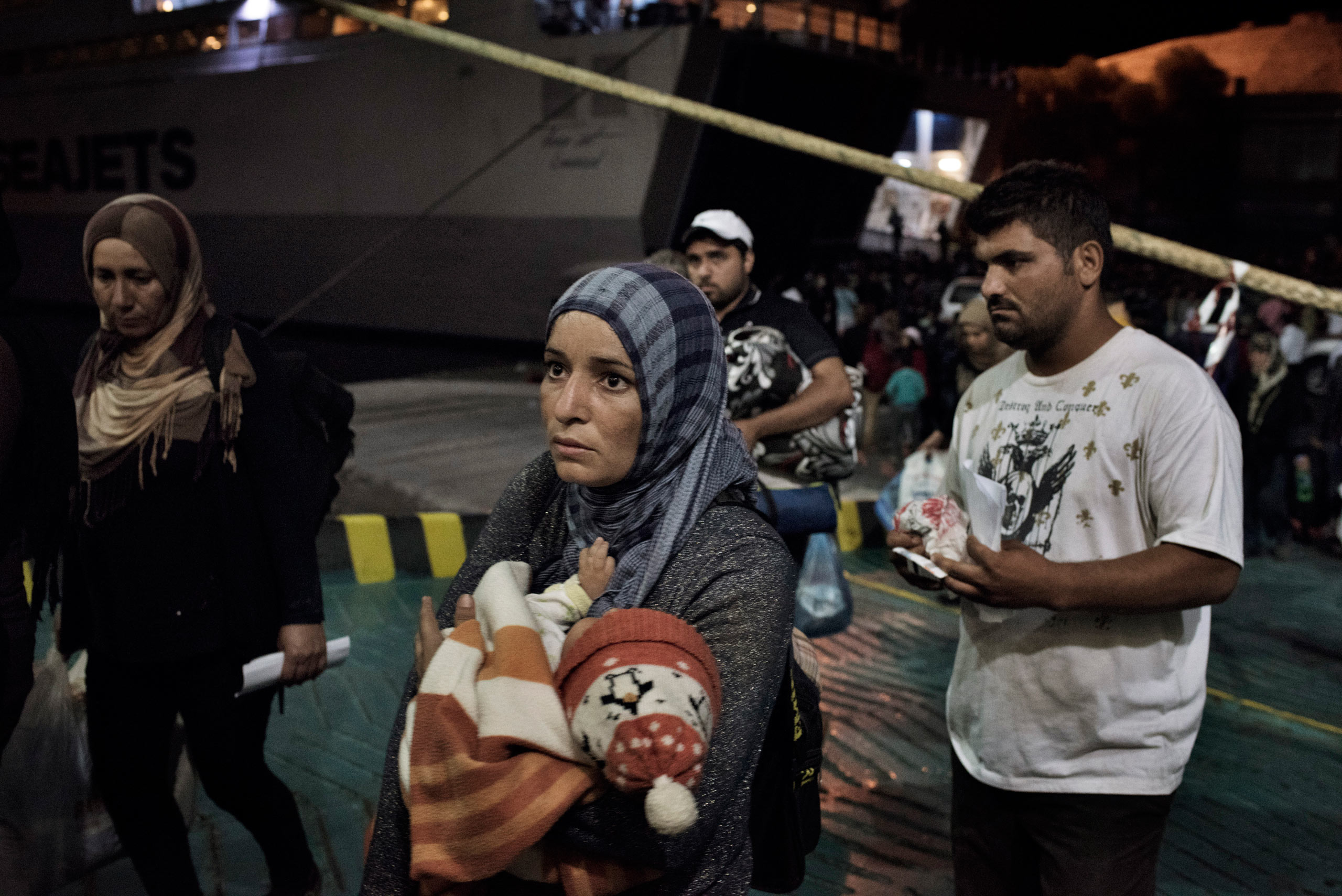 Migrants come aboard a cruise ship that the Greek government chartered to transport them to Athens from the Greek island of Lesbos. Sept. 5, 2015.