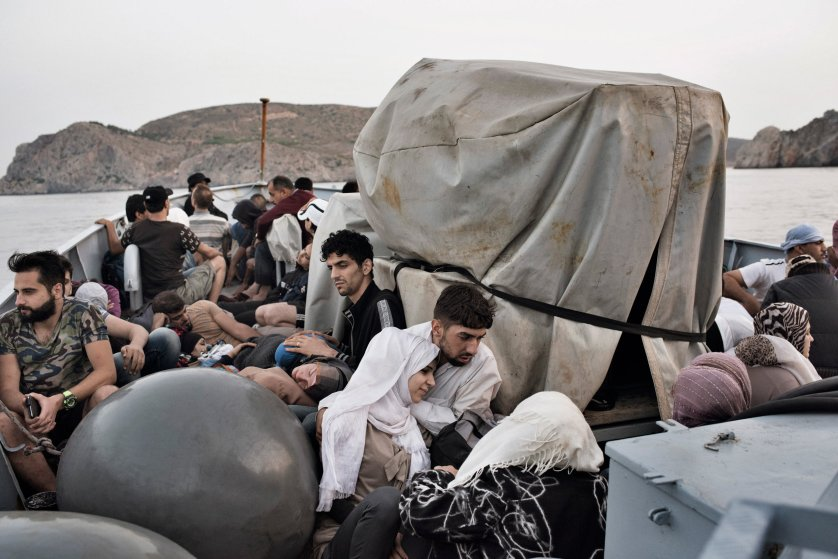 Syrian migrants are taken to Greece aboard a Greek coast guard vessel after it rescued them from waters near the Greek-Turkish border. Sept. 7, 2015.