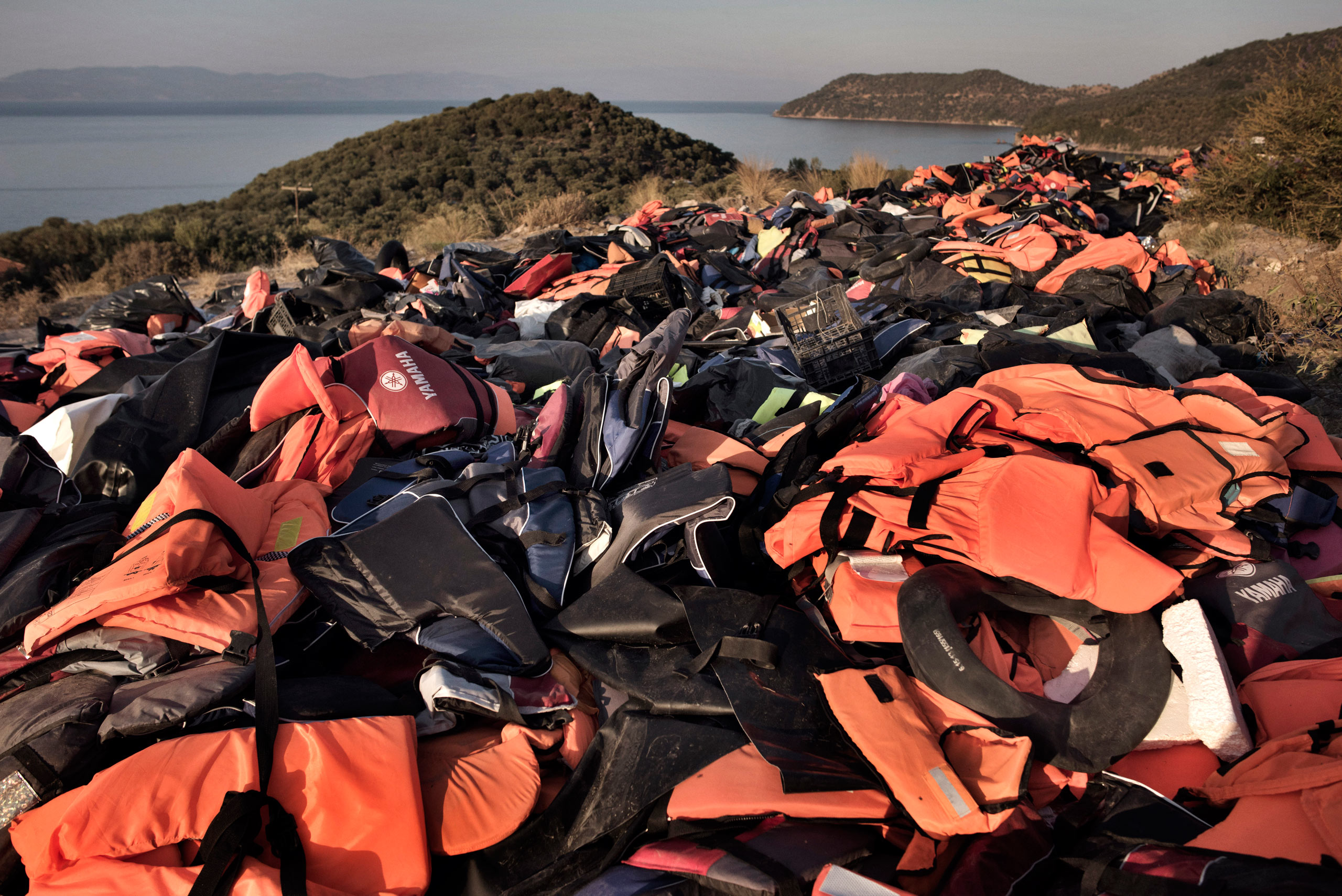 A beach  on the Greek island of Lesbos is festooned with orange life jackets and deflated rafts abandoned by migrants who are coming ashore near the village of Skala Sikamineas after navigating the 6-mile crossing from Turkey on  inflatable rafts.  Between 2,000 and 3,500 migrants now reach the island daily, riding on about 100 inflatable rafts. Sept. 15, 2015.